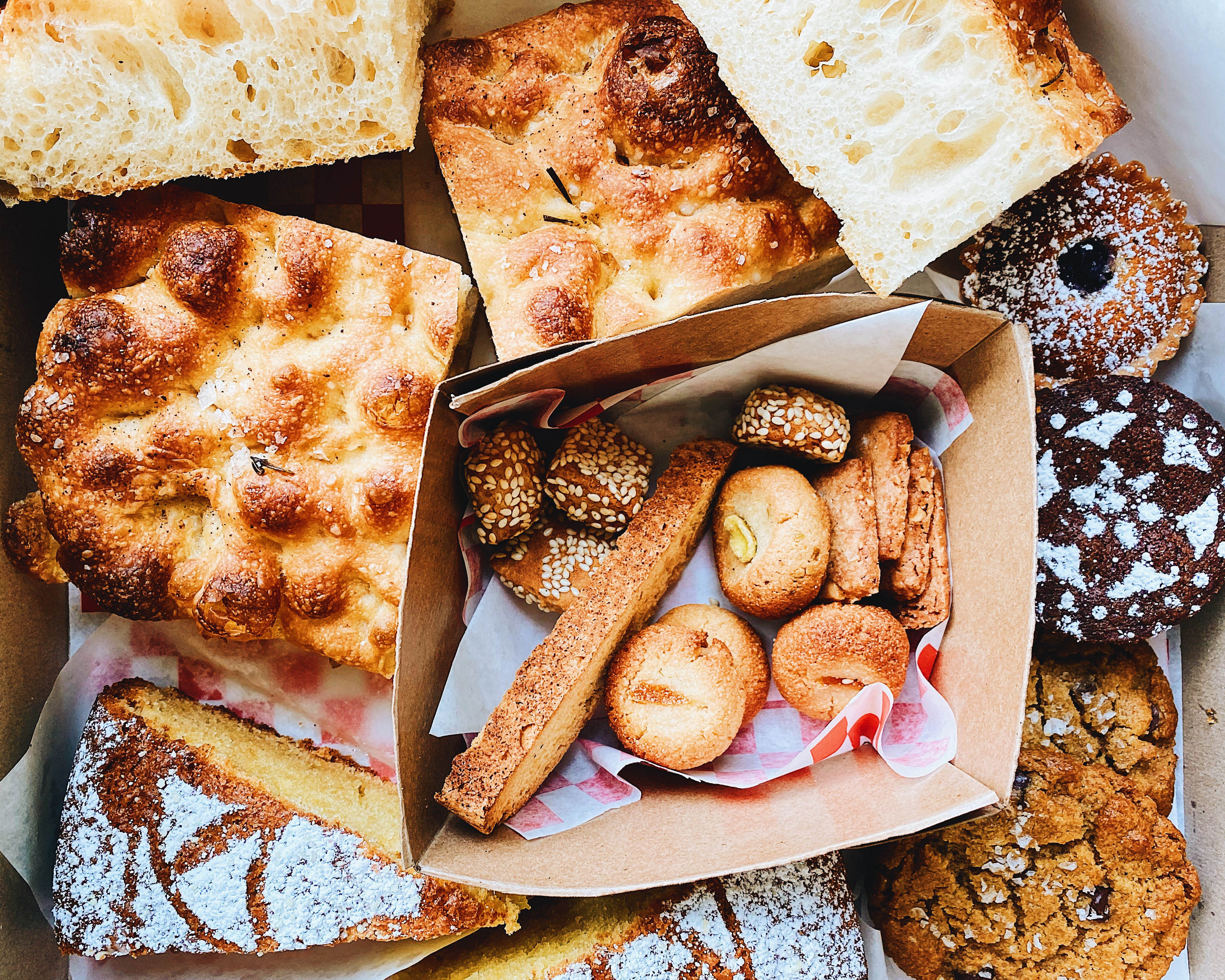 A box of focaccia, Italian cookies, and olive oil cake from Sebastiano's