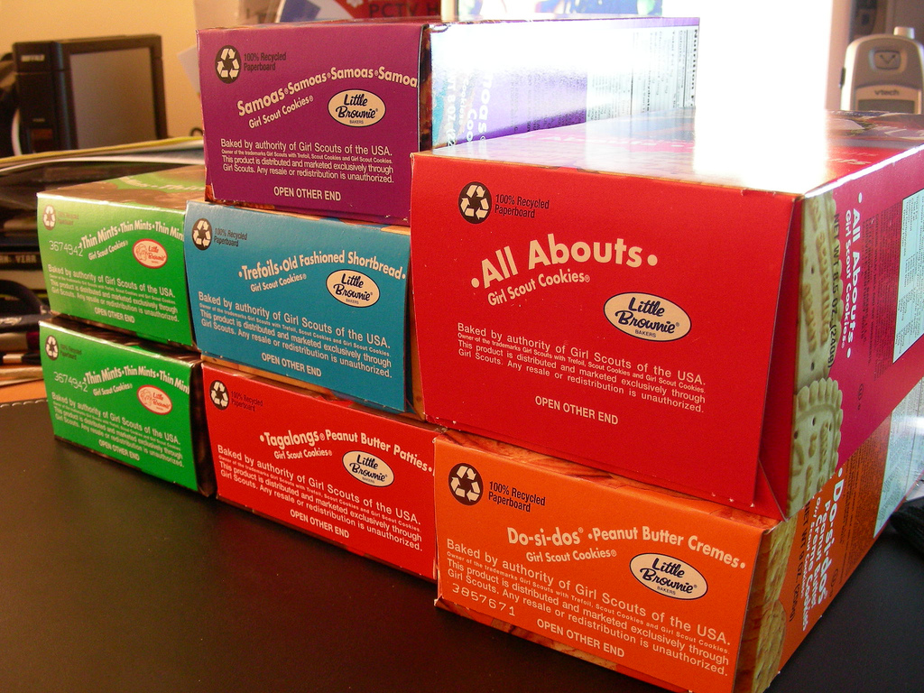 Stacked boxes of Girl Scout cookies.