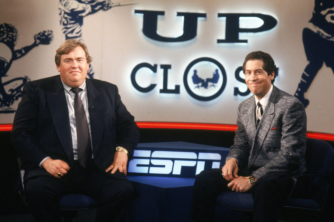 MAY 1991: Sportscaster Roy Firestone sits with John Candy on the set of ESPN's 'Up Close.'