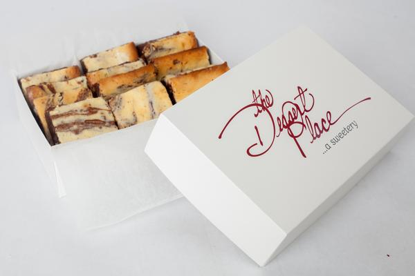 A box of The Dessert Place cream cheese brownies.