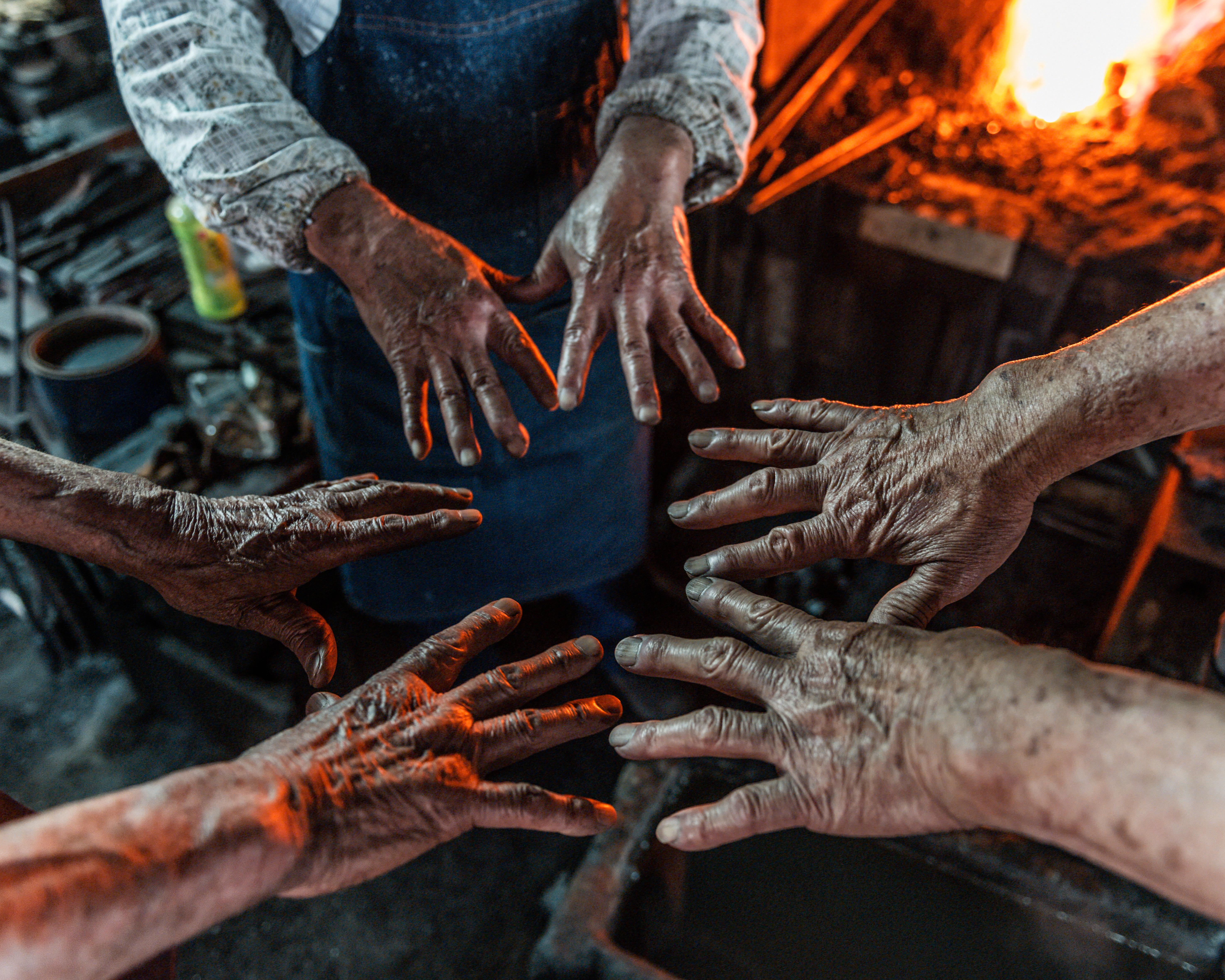 The hands of Noriyuki, Kitai, and Kenji Yoshida, toolmakers and blacksmiths in the town of Shimabara, on the southern island of Kyushu.