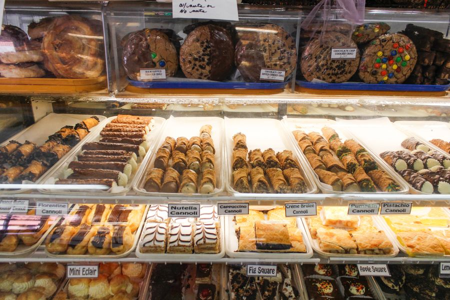 A view of Bova's Bakery's pastry case, including cookies, cannoli, eclairs, and more