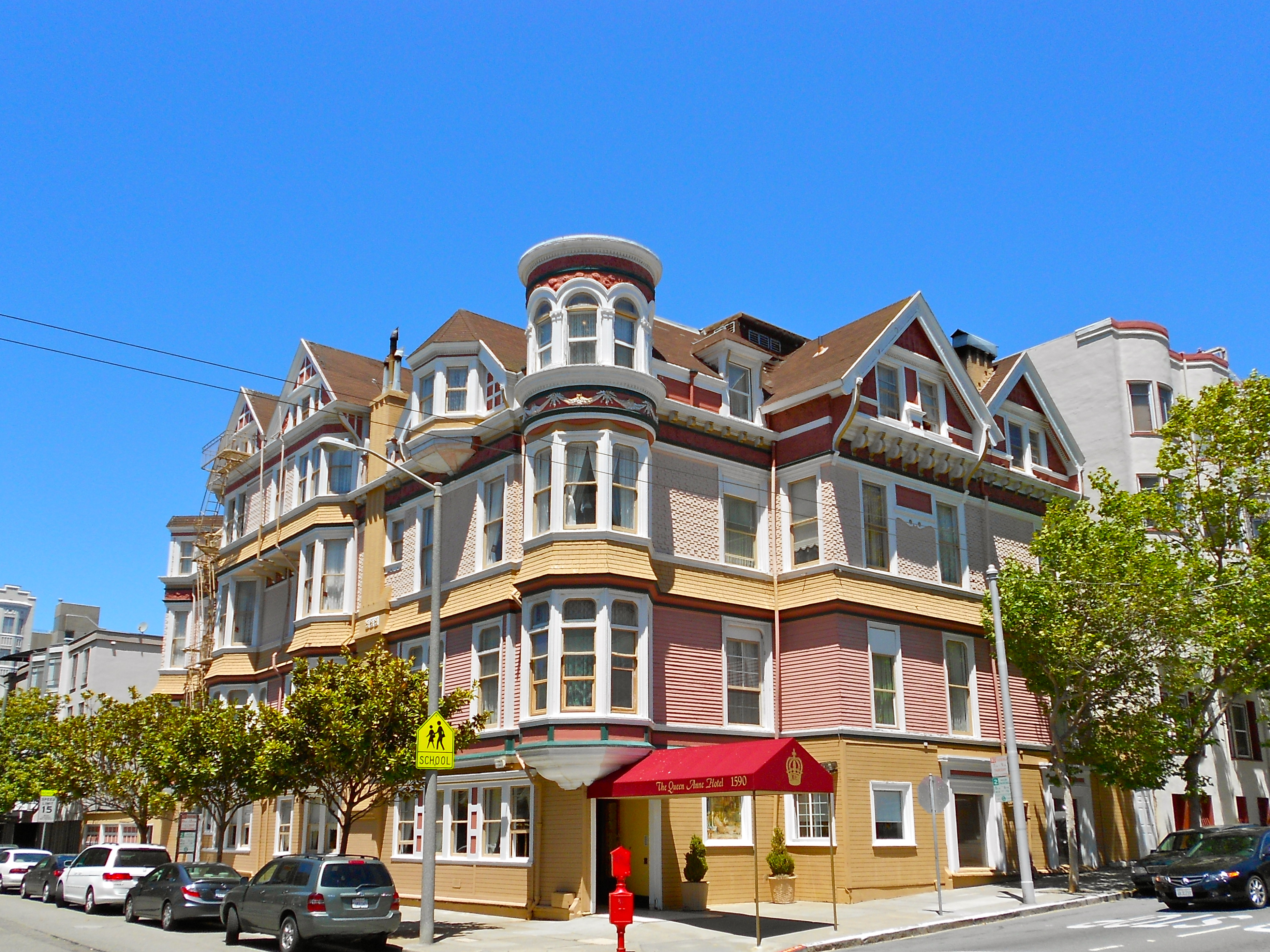 A big, yellow Victorian hotel with many bay windows.
