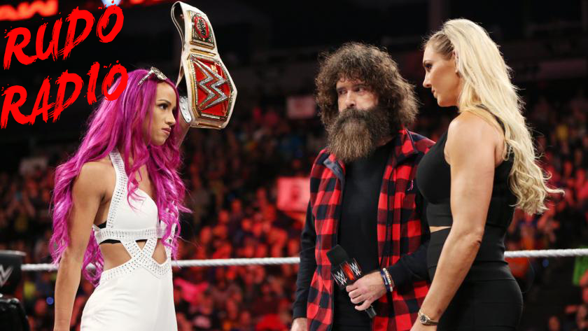 Sasha Banks and Charlotte sign the contract for a Women's Championship match.