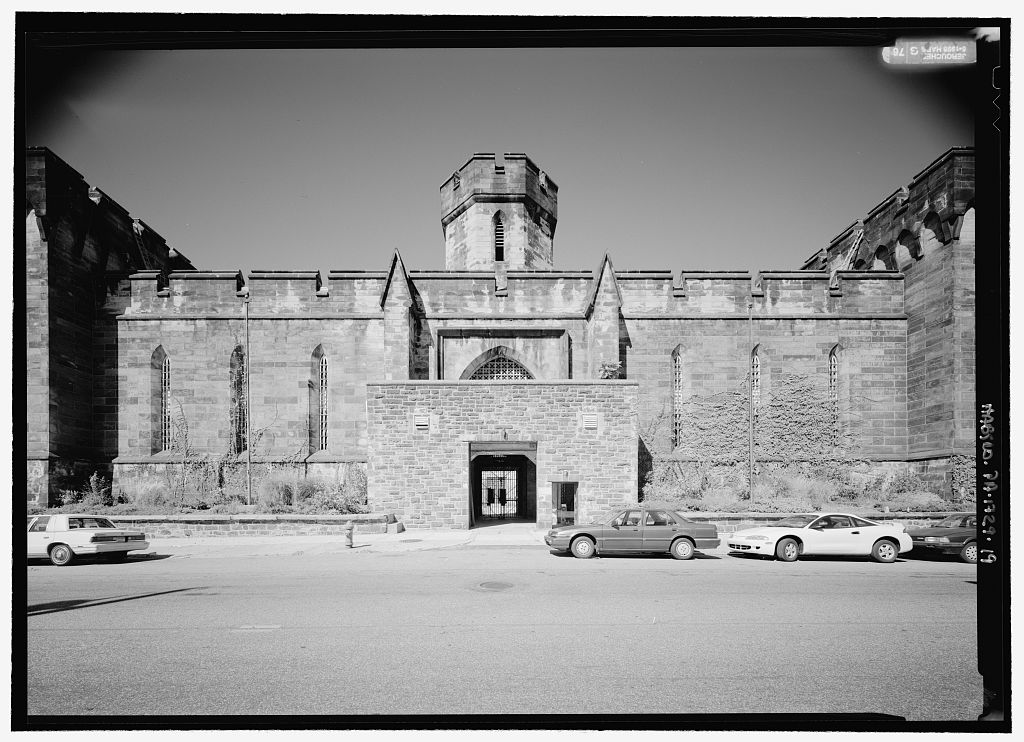 A black and white photo of the entrance to the Eastern State Penitentiary in Philadelphia.