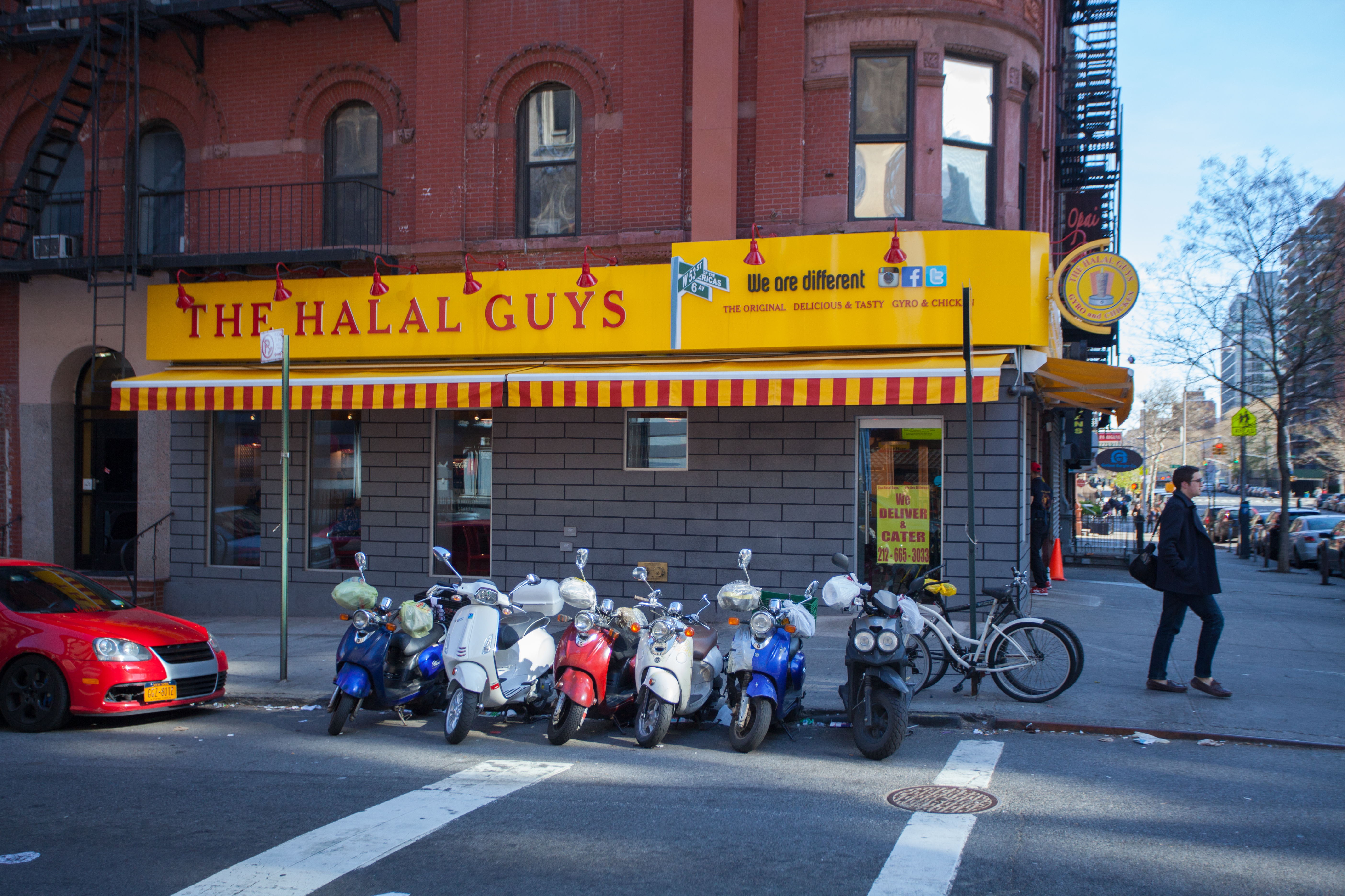 Exterior signage at a New York location for The Halal Guys.