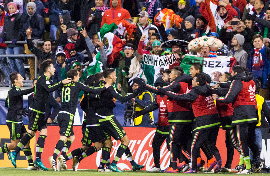 Mexican fans and players celebrate their first ever goal in Columbus
