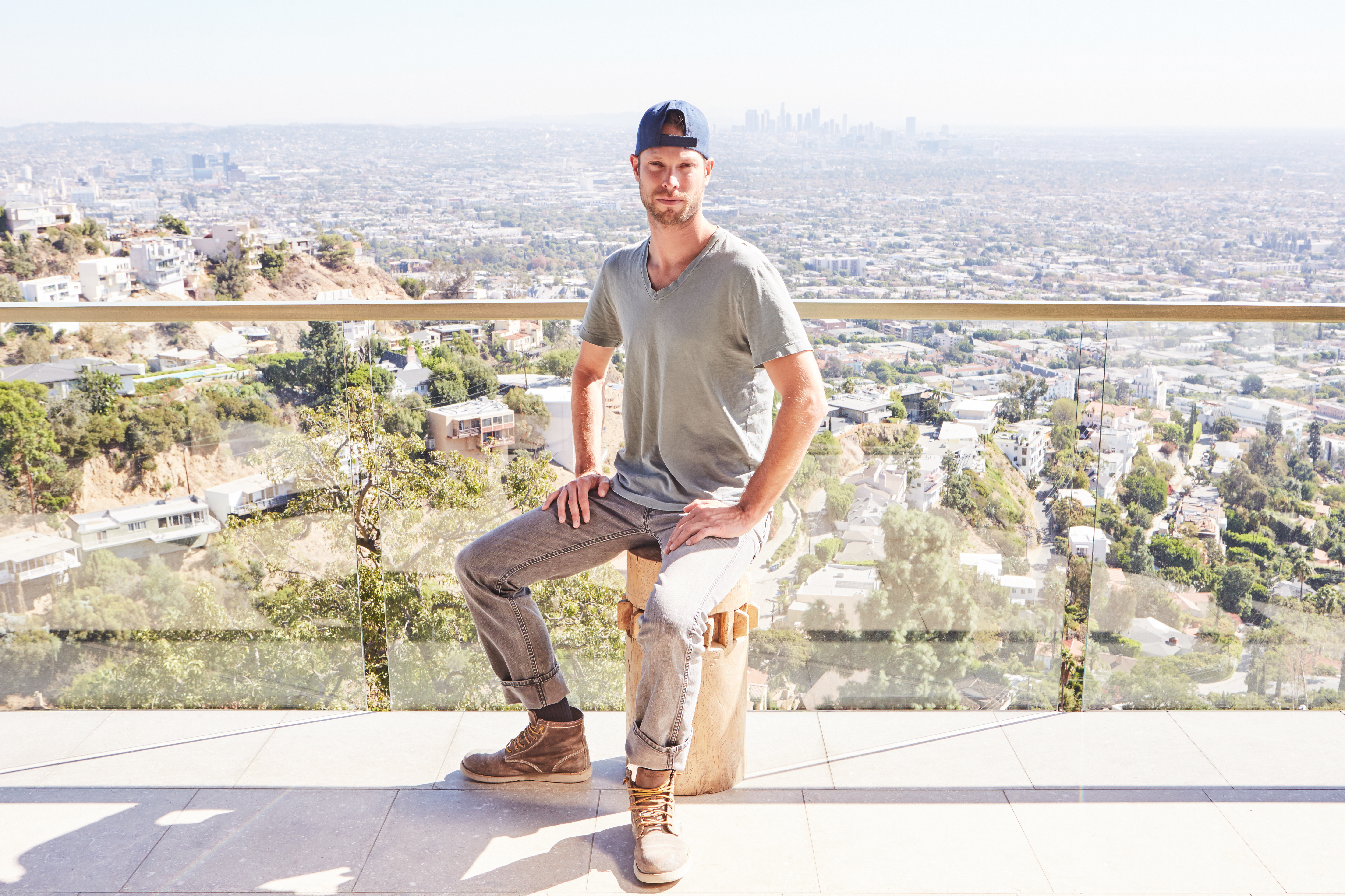 Kyle Fishburn on the deck of a home that he designed in Los Angeles.