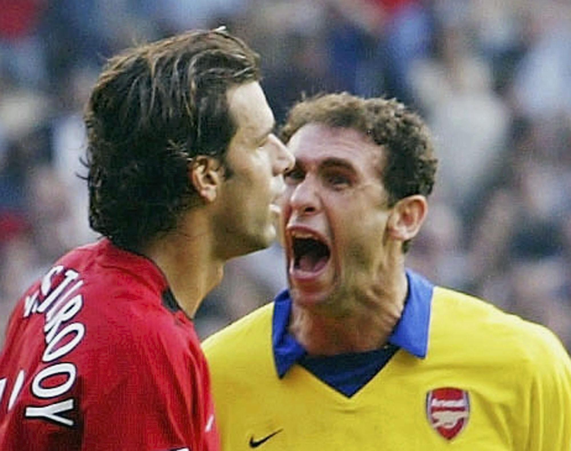 Martin Keown and Ruud Van Nistelrooy argue
