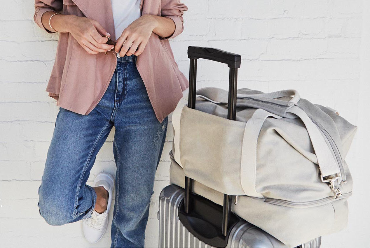 A woman standing by luggage