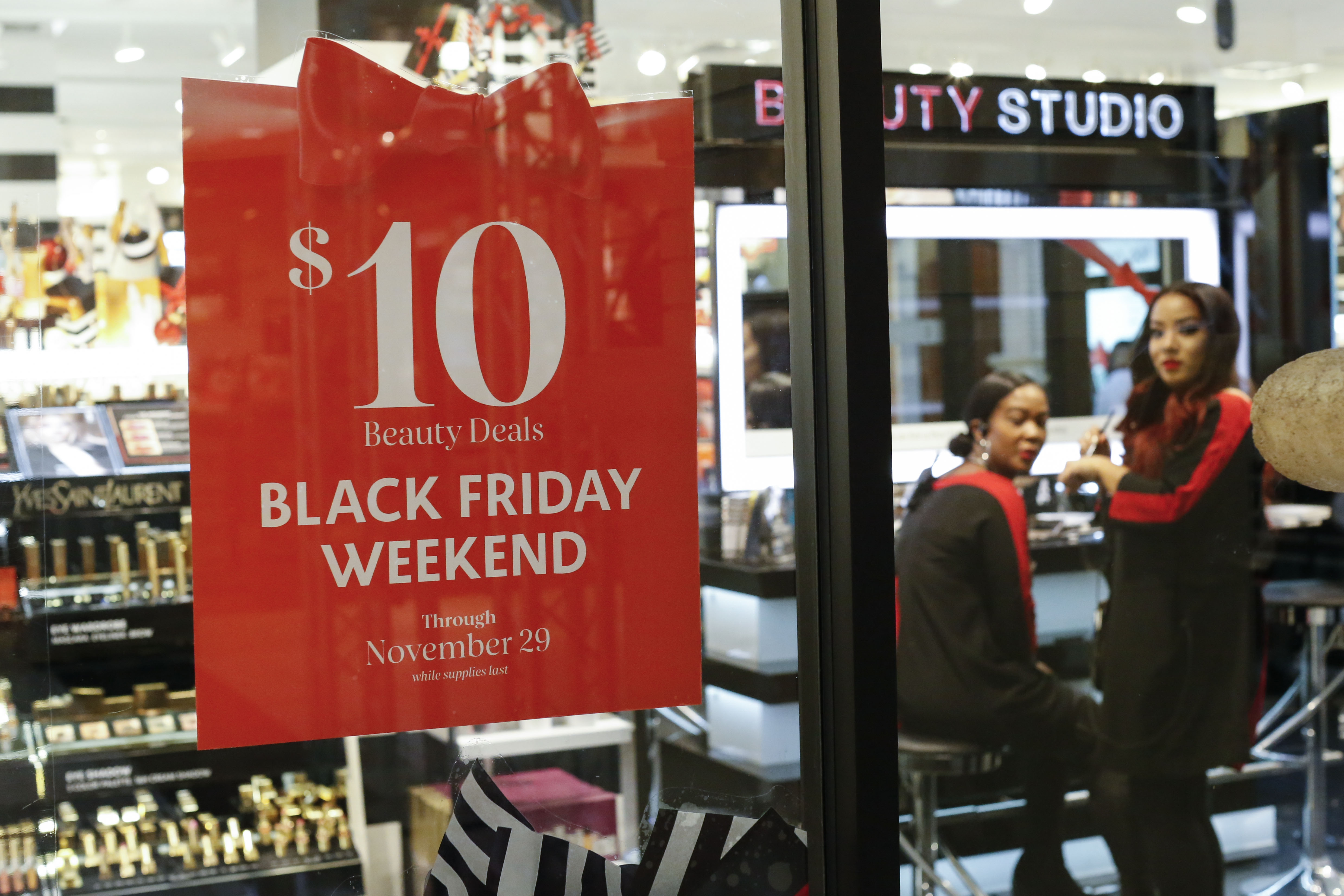 A Black Friday sale sign in a Sephora store.