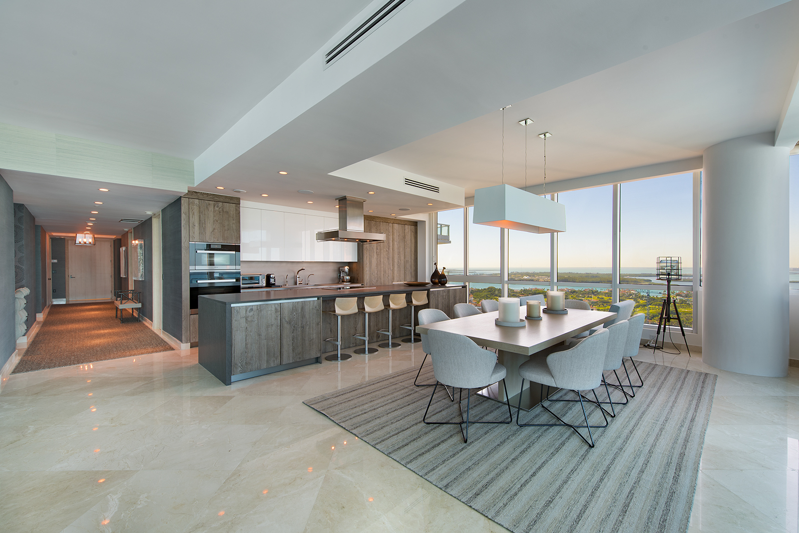 A modern and open kitchen in a high-rise apartment overlooking South Beach, the ocean, and Downtown Miami