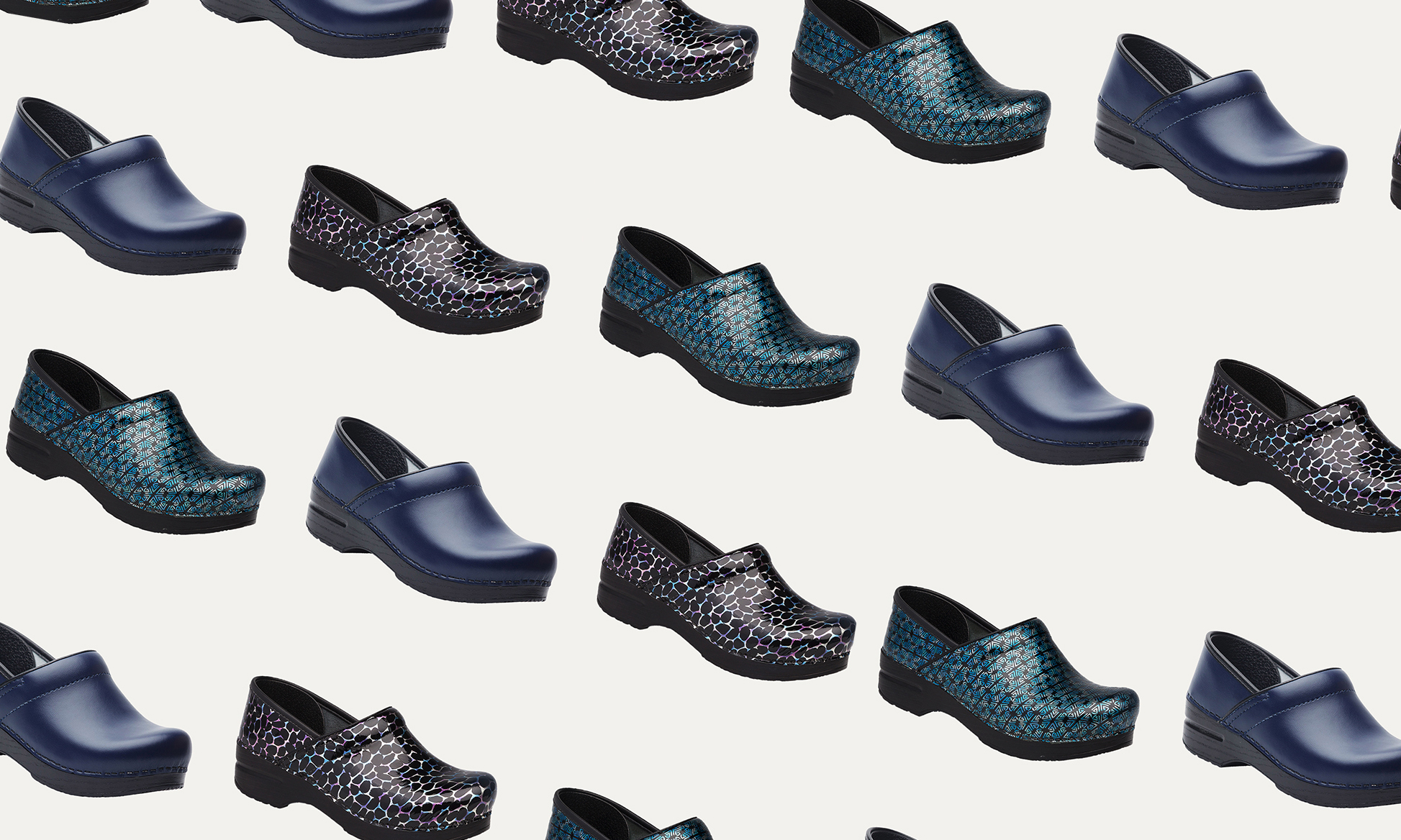 A bunch of Dansko Professional Clogs on a light background