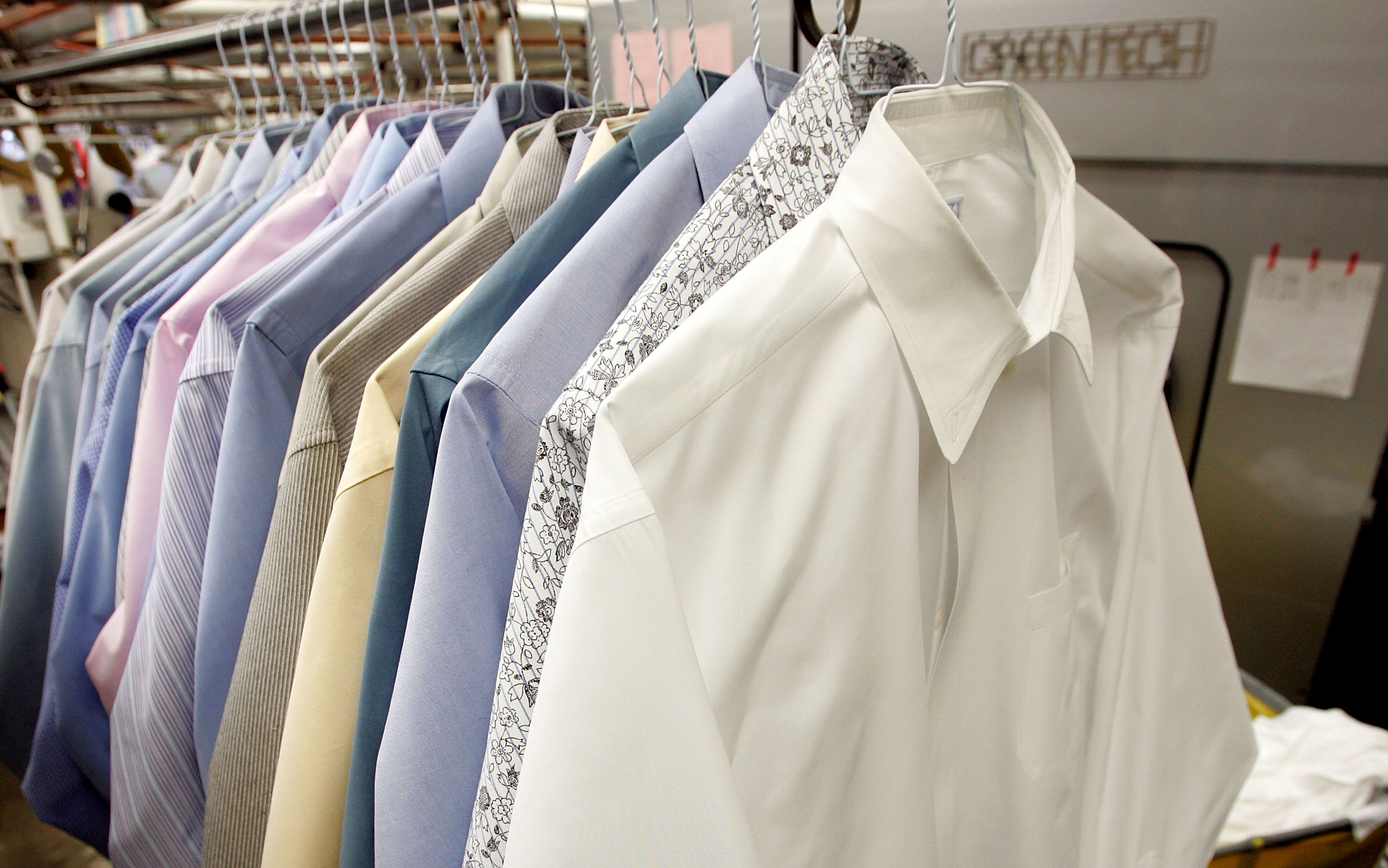 Button-down shirts at a dry cleaner's.