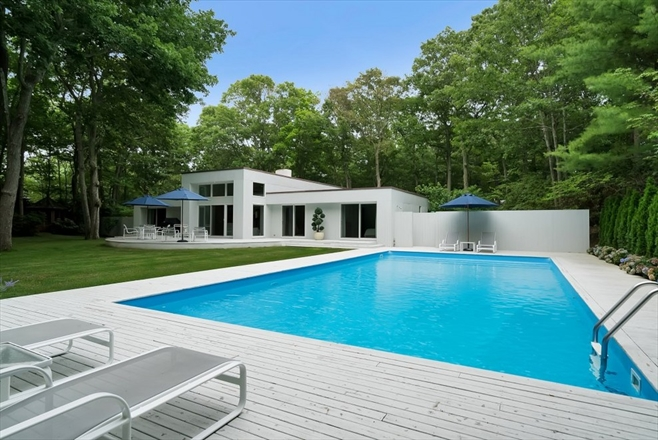 contemporary home exterior rear with pool