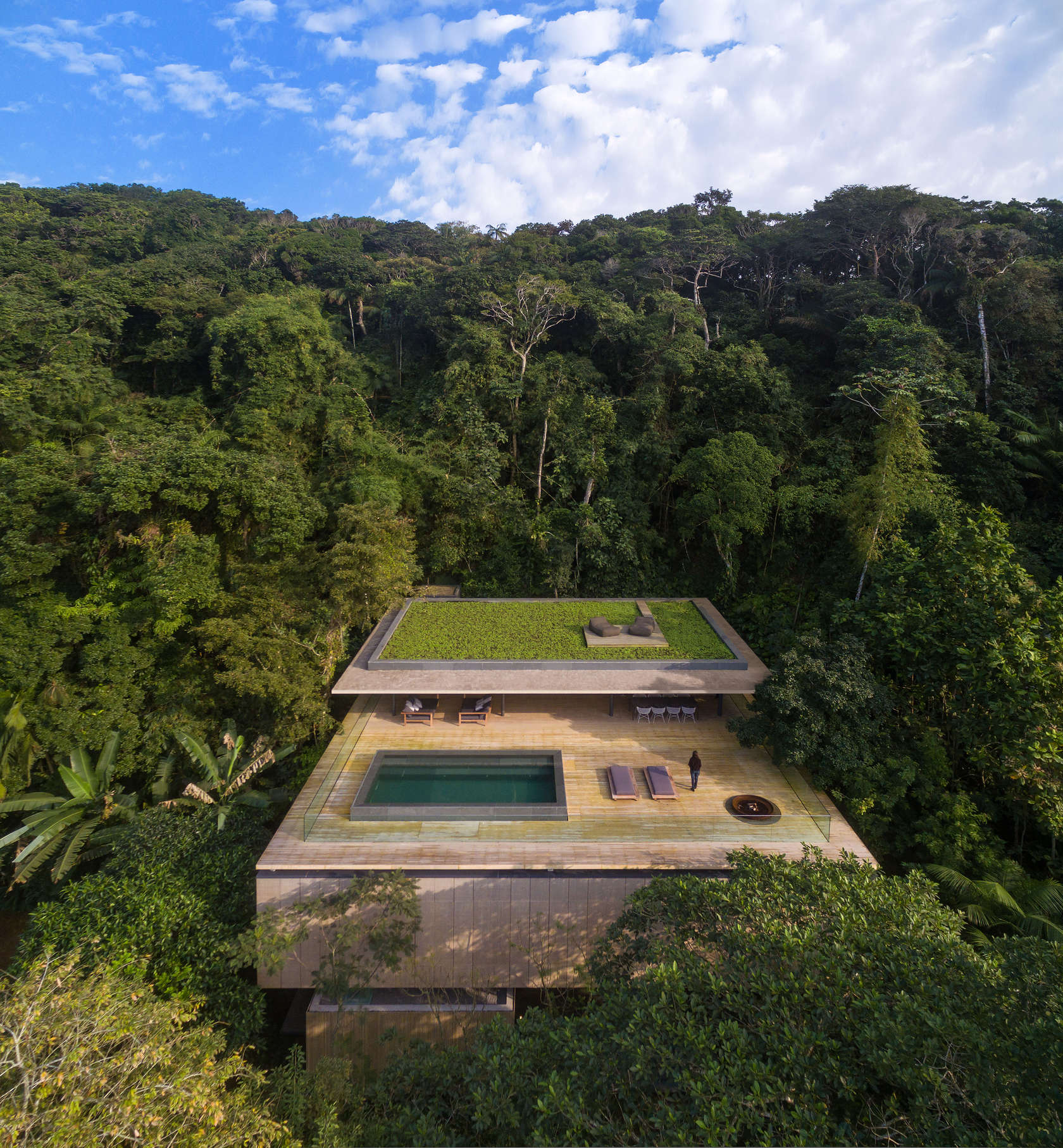 Stunning modern house in Brazil's rain forest has cozy sunken living room, green roof