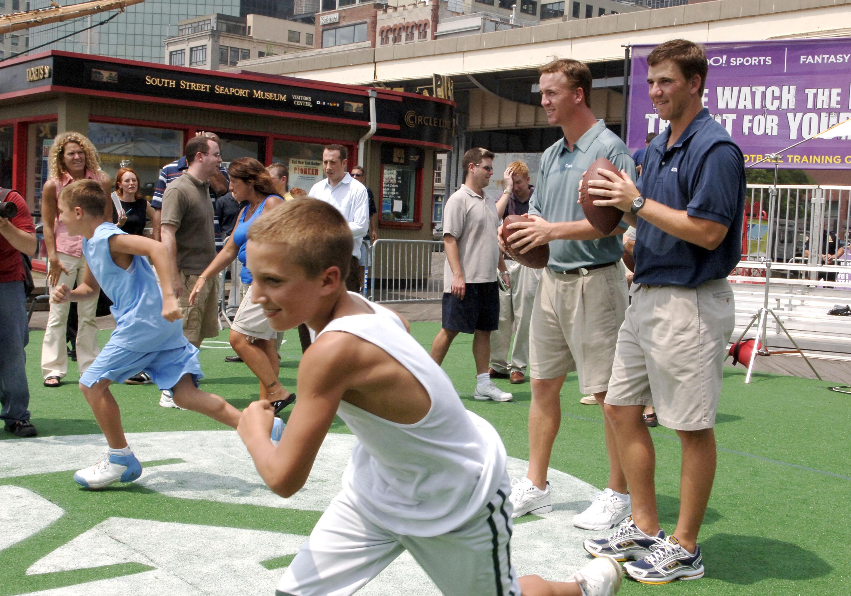 Peyton Manning and Eli Manning Kick off 2005 Fantasy Football Season