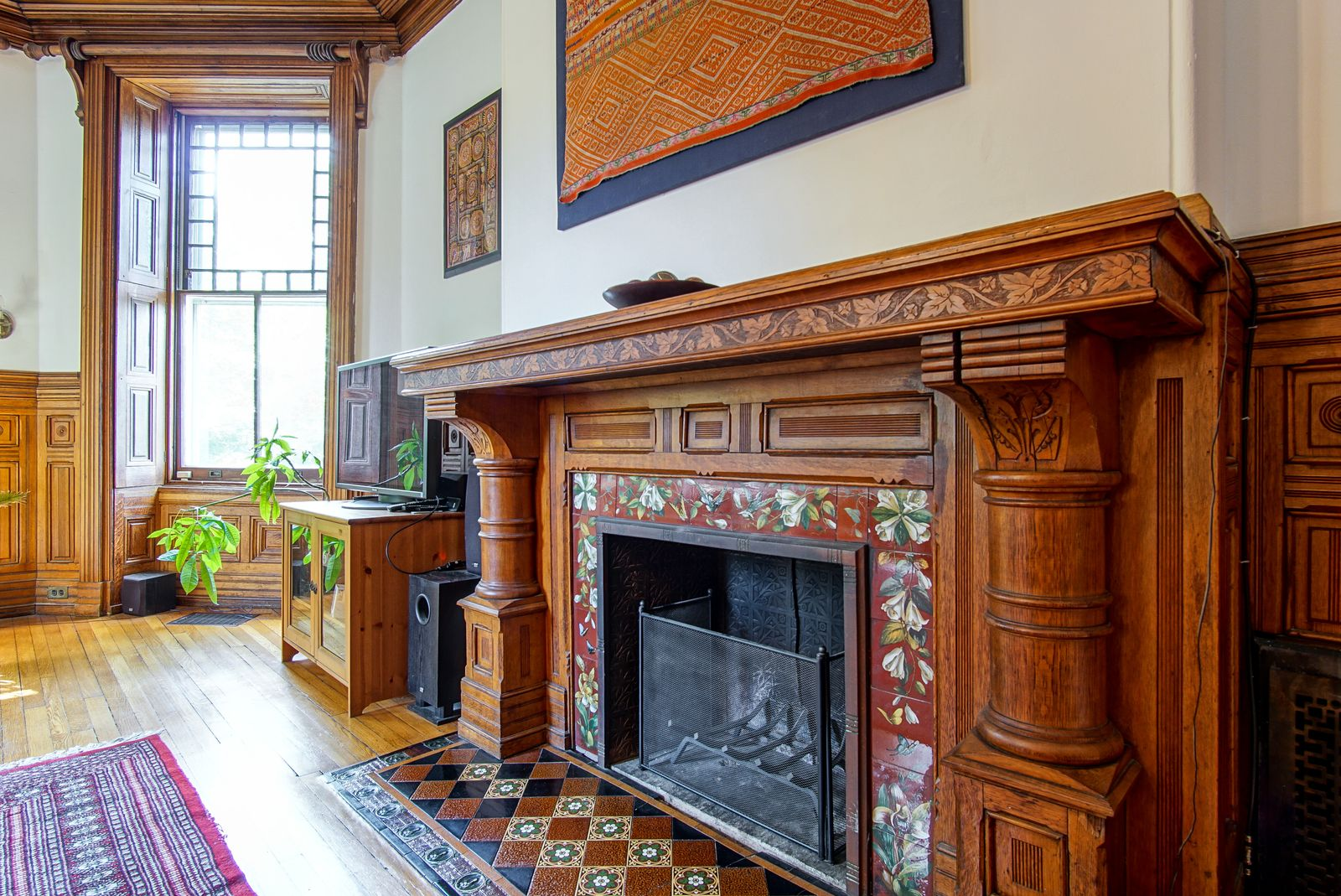 A closeup shot of a fireplace with lovely tiling.