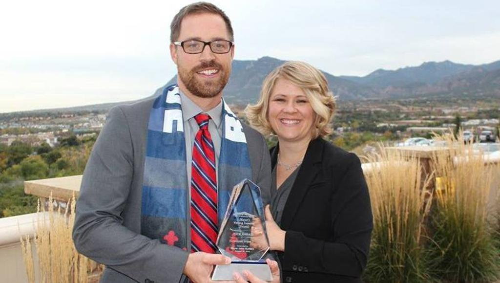 """Switchbacks FC President Nick Ragain and wife Jessica receiving the mayors """"Young Leaders Award - Economic Impact"""" for 2015"""