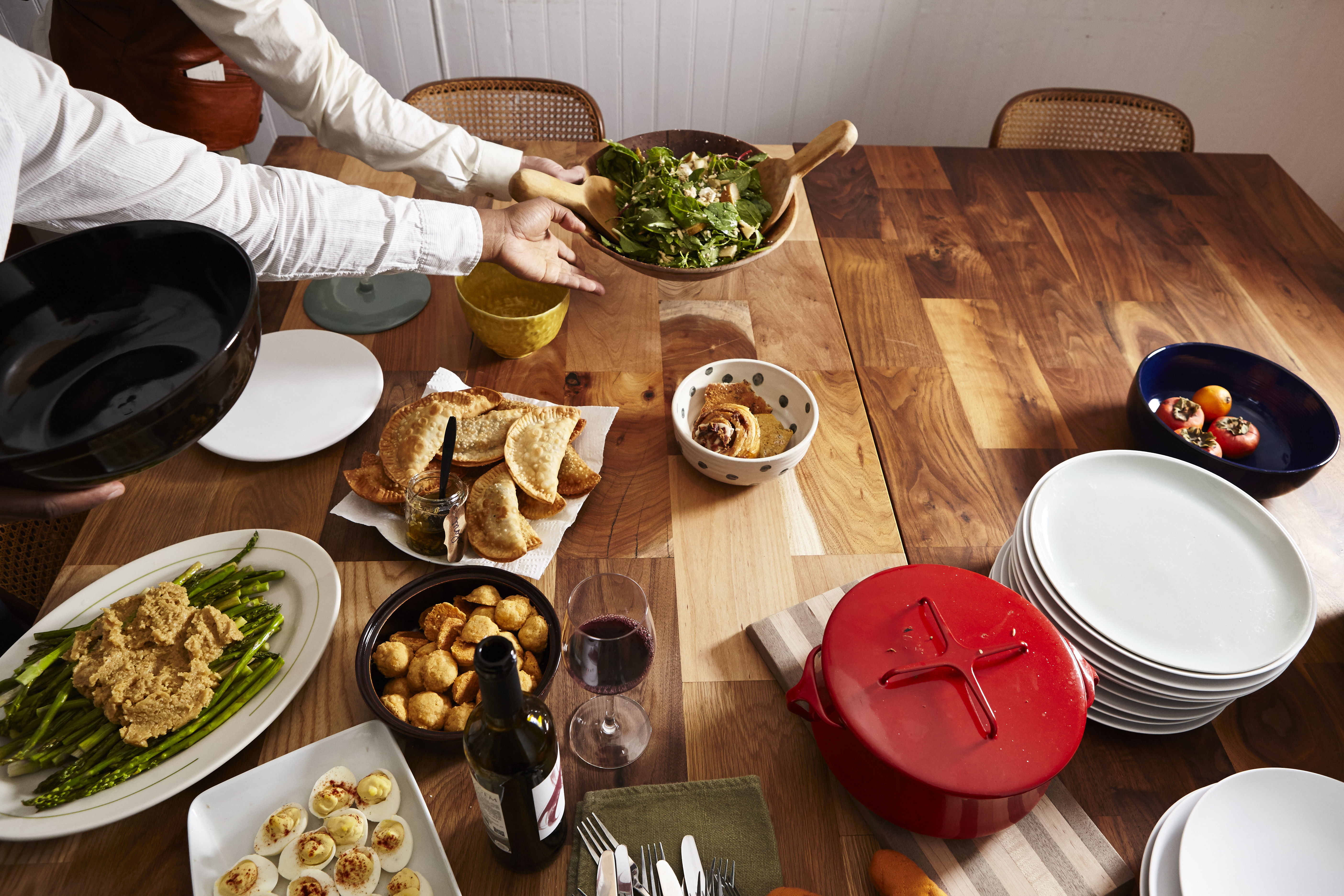 A table of food at a dinner party.