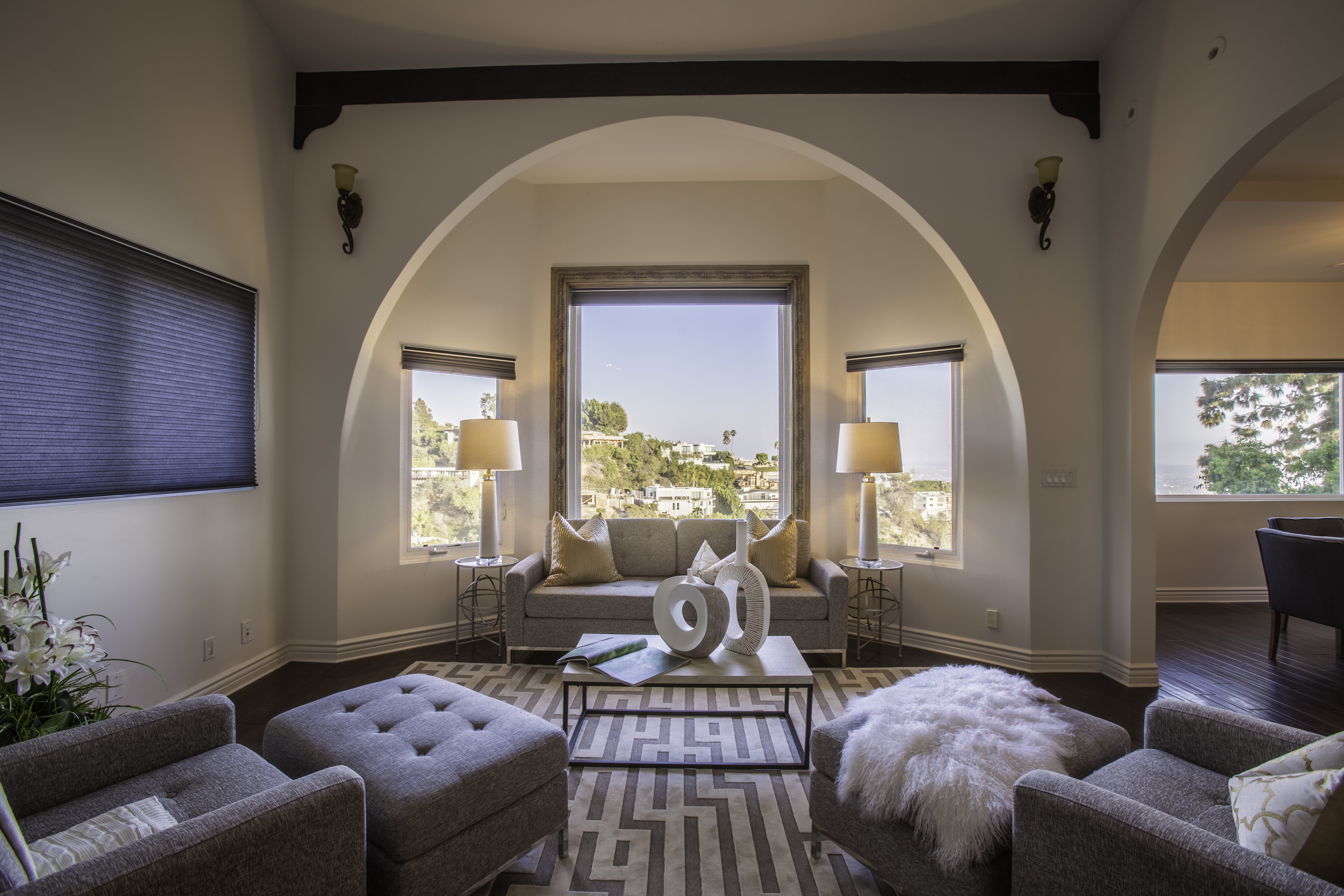 Living room with archway and three windows