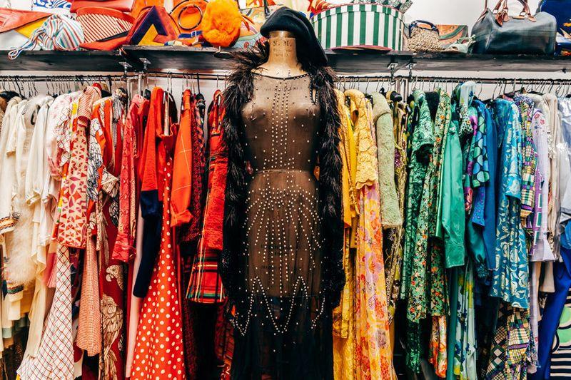 Dresses on mannequins and racks inside the Manhattan Vintage Show