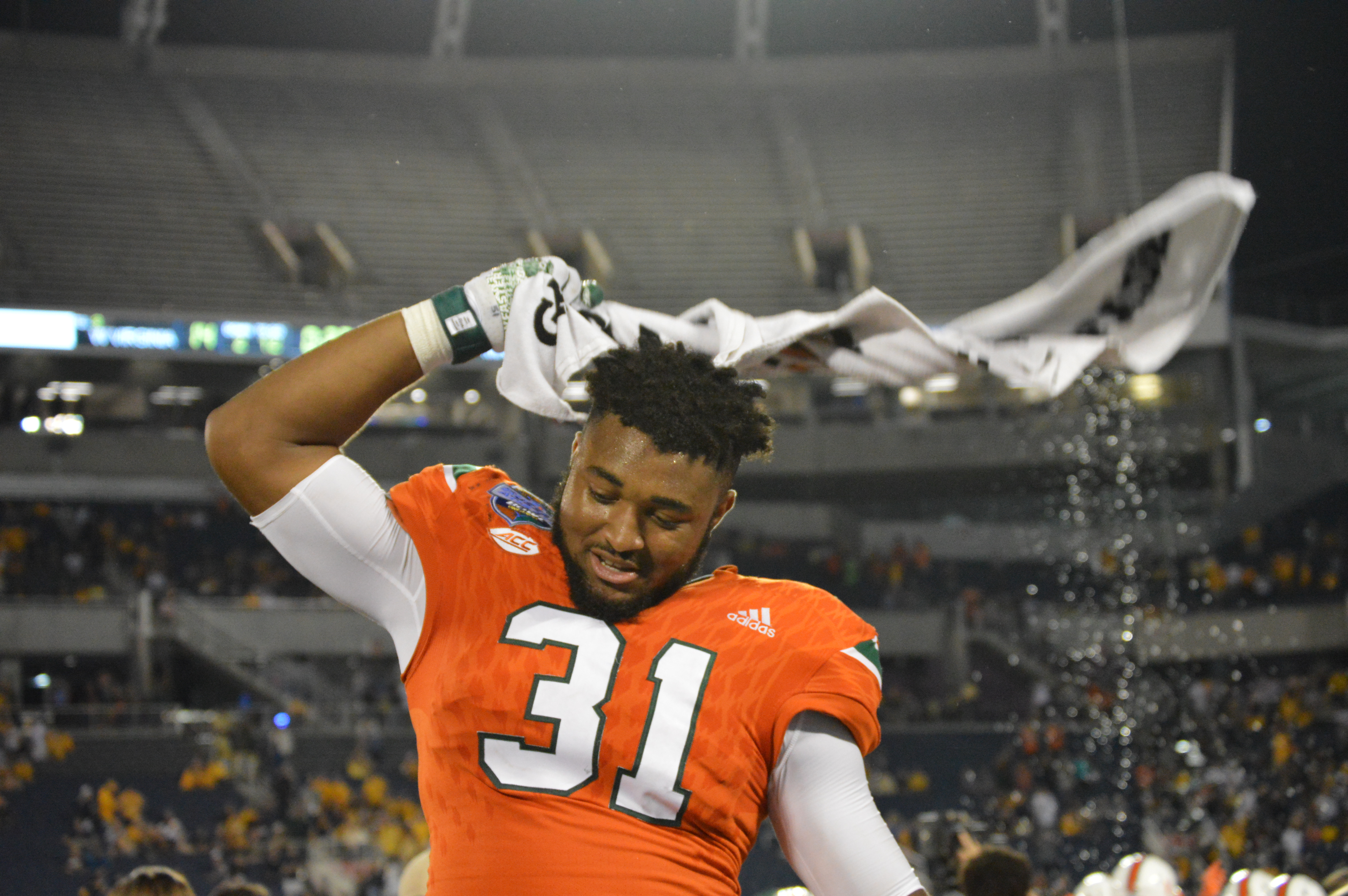 D Jax celebrates Miami's first bowl win in .... like forever