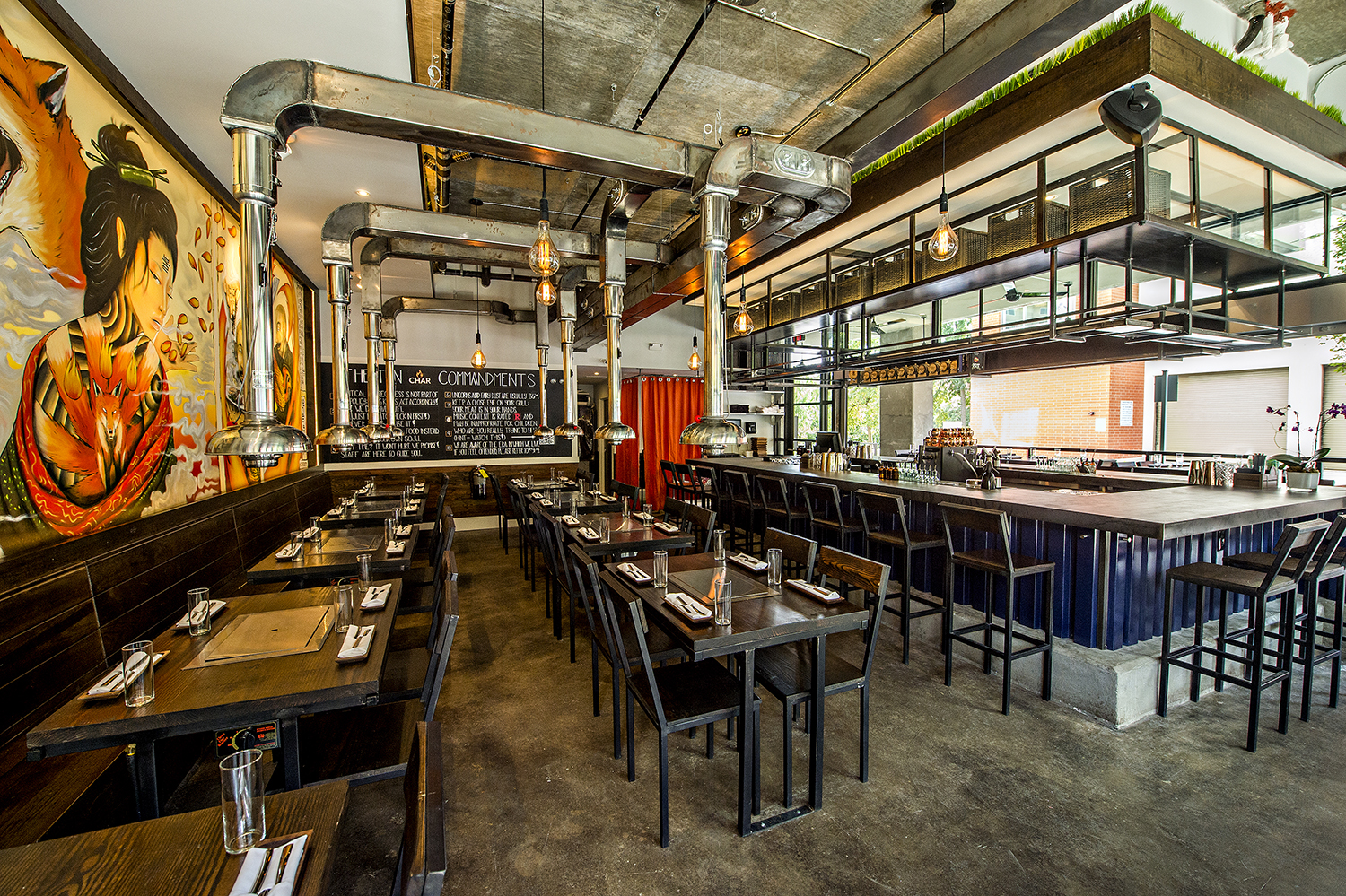 A view of the dining room, bar, and patio at Char Korean Bar & Grill.