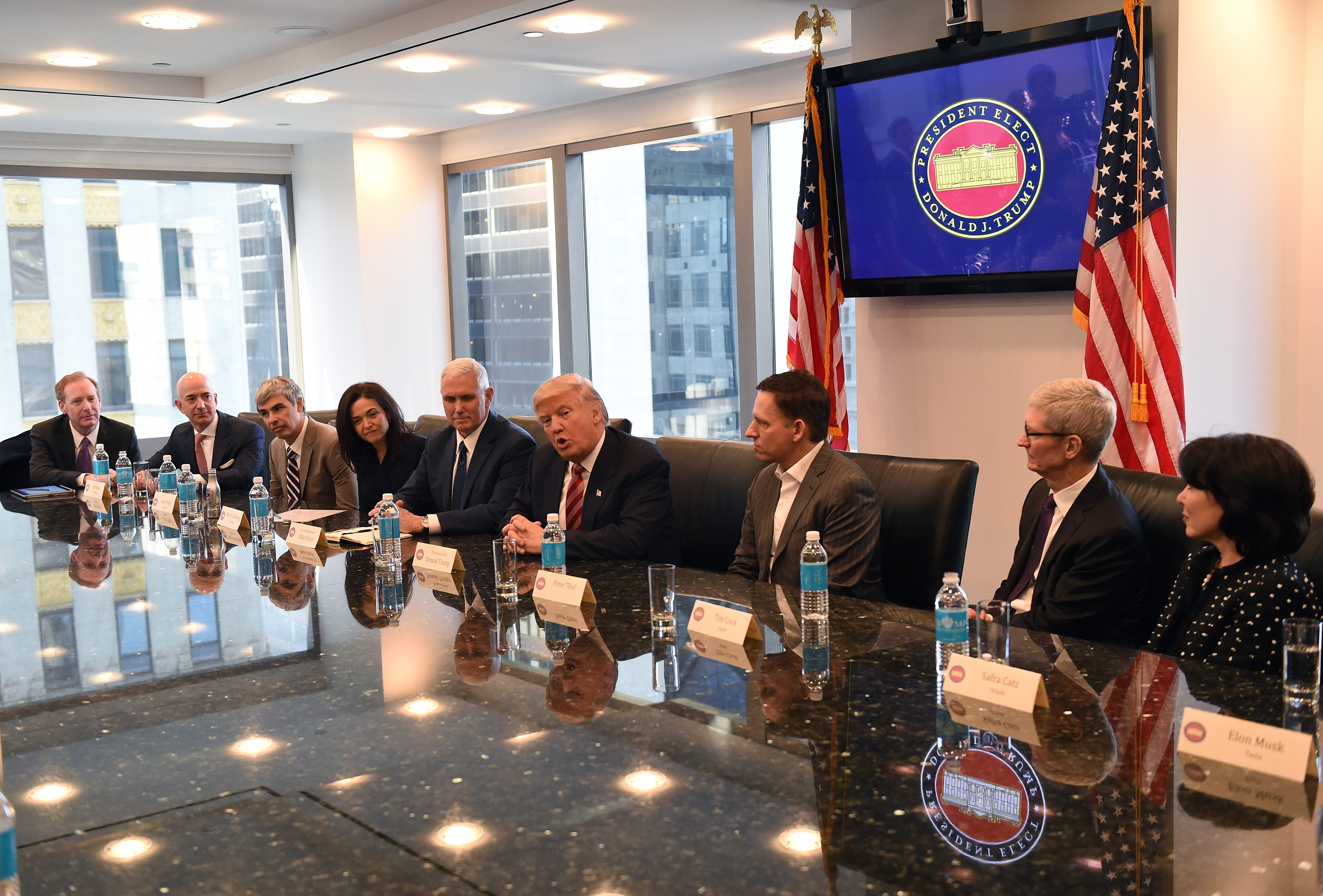 Amazon's chief Jeff Bezos, Larry Page of Alphabet, Facebook COO Sheryl Sandberg, Vice President elect Mike Pence, President-elect Donald Trump, Peter Thiel, co-founder and former CEO of PayPal, Tim Cook of Apple and Safra Catz of Oracle attend a meeting a