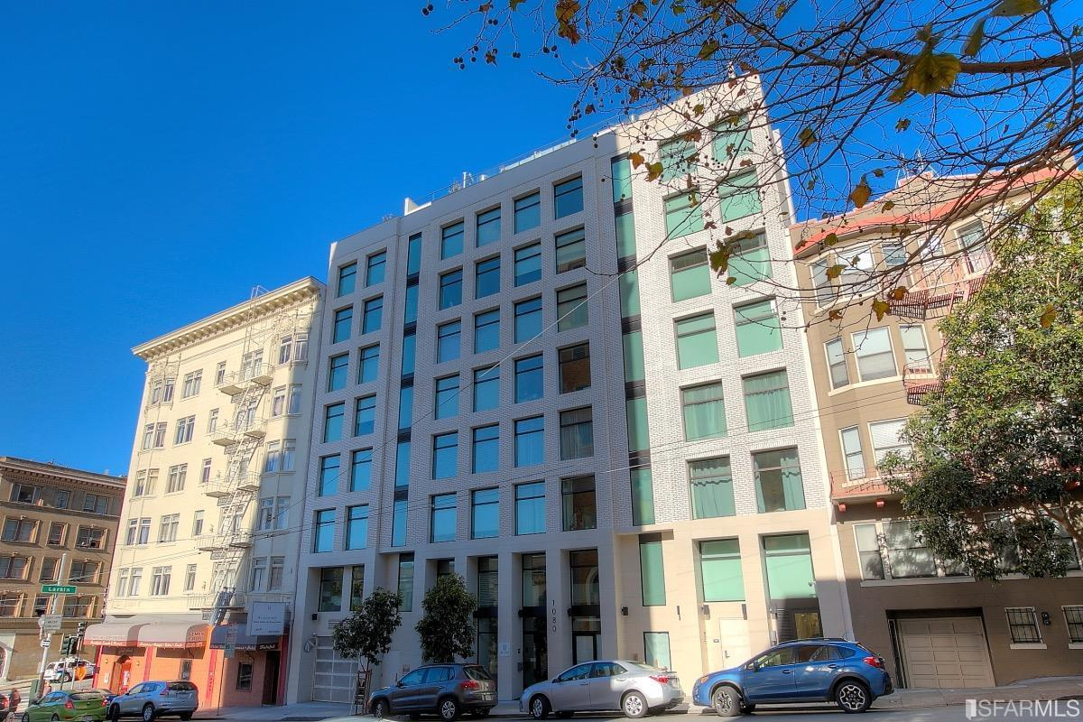 The white facade of the condo building at 1080 Sutter Street