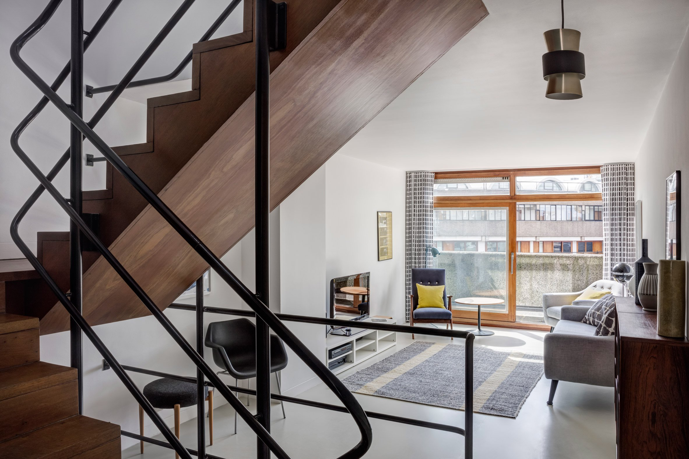 Renovated 1950s apartment glows anew in a London Brutalist icon