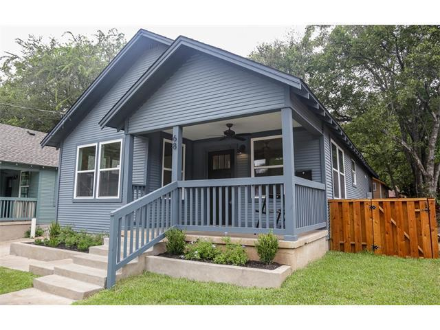 1926 wood frame house renovated, light blue/gray paint, basic bungalow style