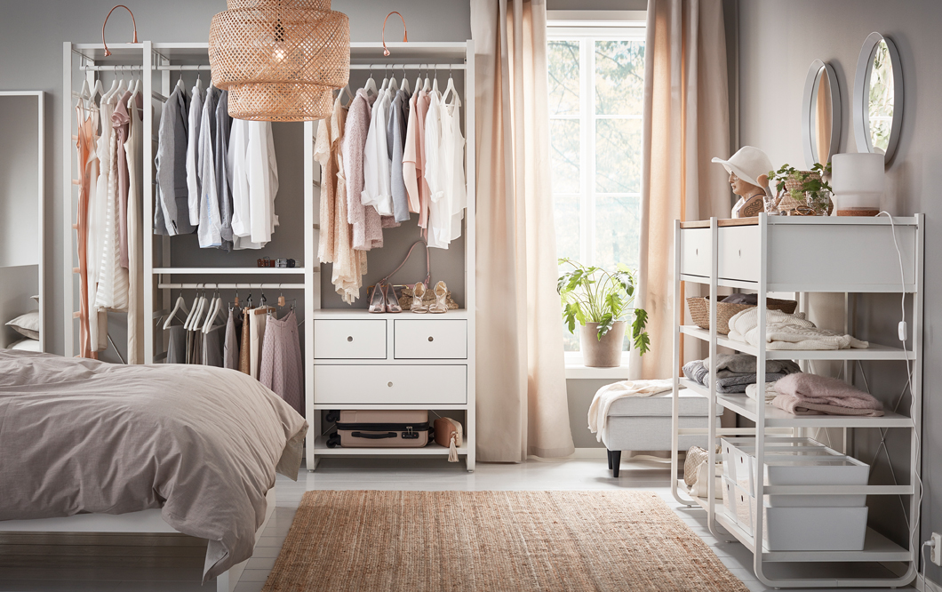 An Ikea-furnished bedroom with a nicely organized closet