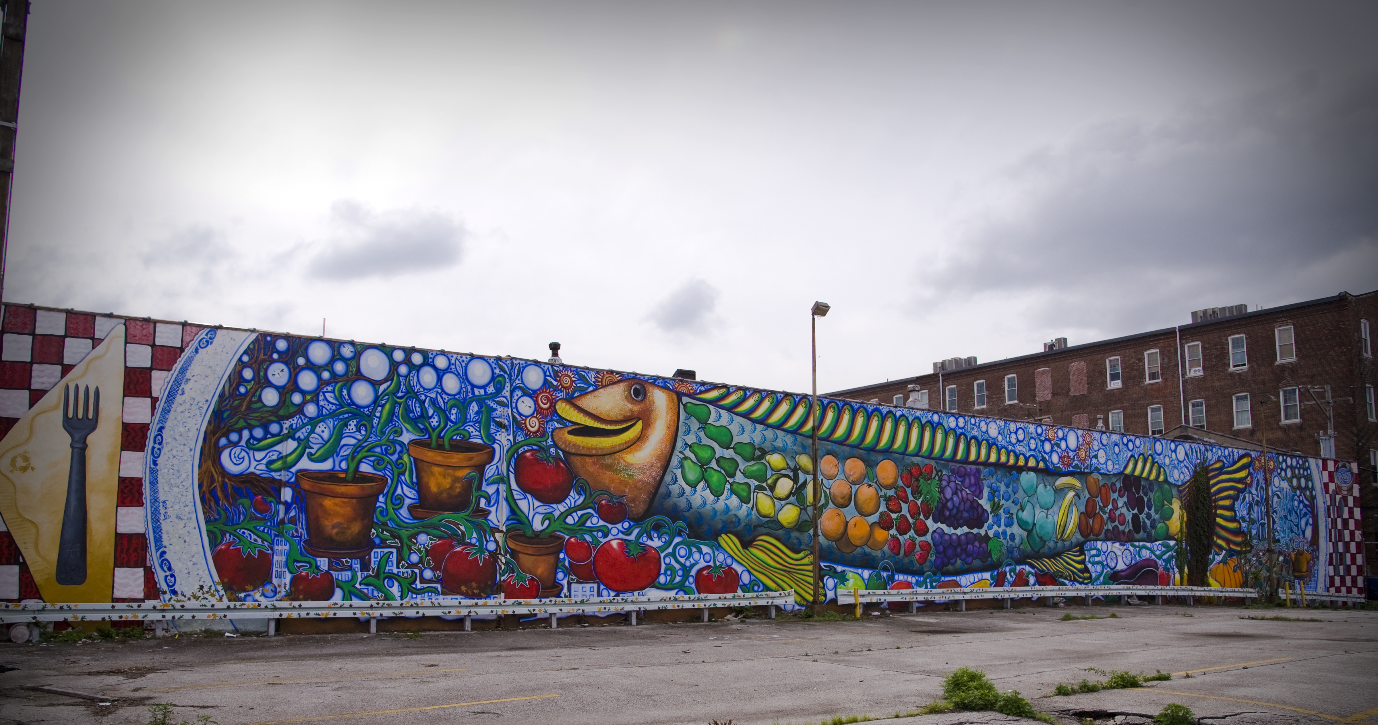 A long mural with a colorful fish