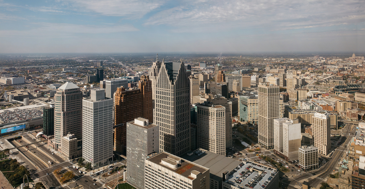 An aerial view of downtown Detroit. There are multiple city buildings and skyscrapers.