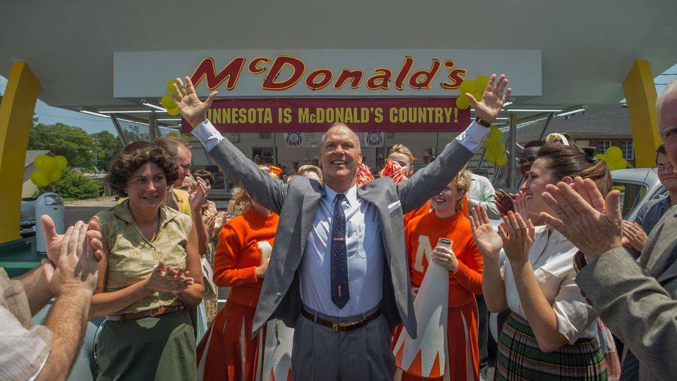 Movie clip with Ray Croc standing arms outstreached in front of a 1950s McDonald's.