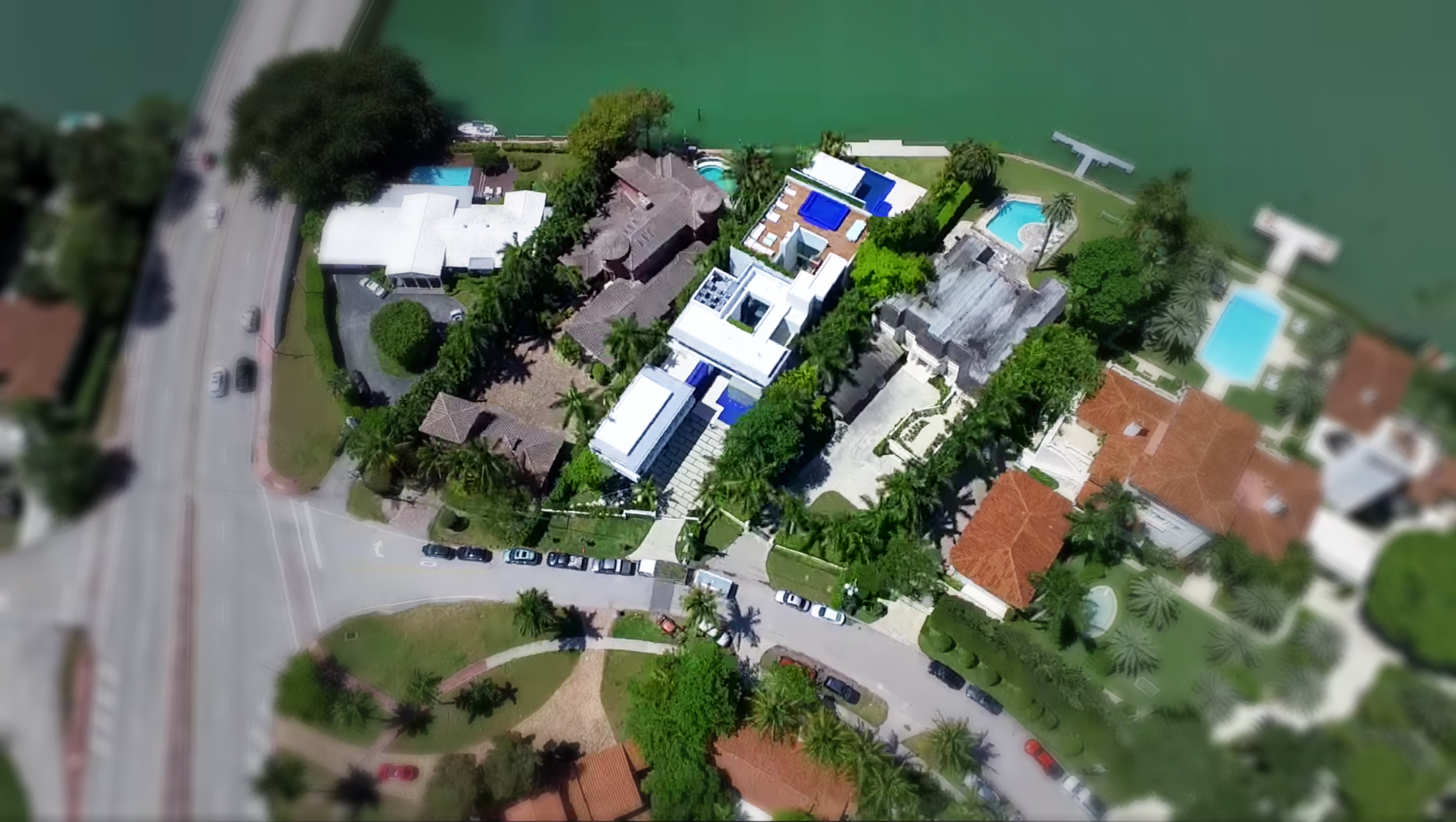 Aerial of a Miami beach mansion on the bay