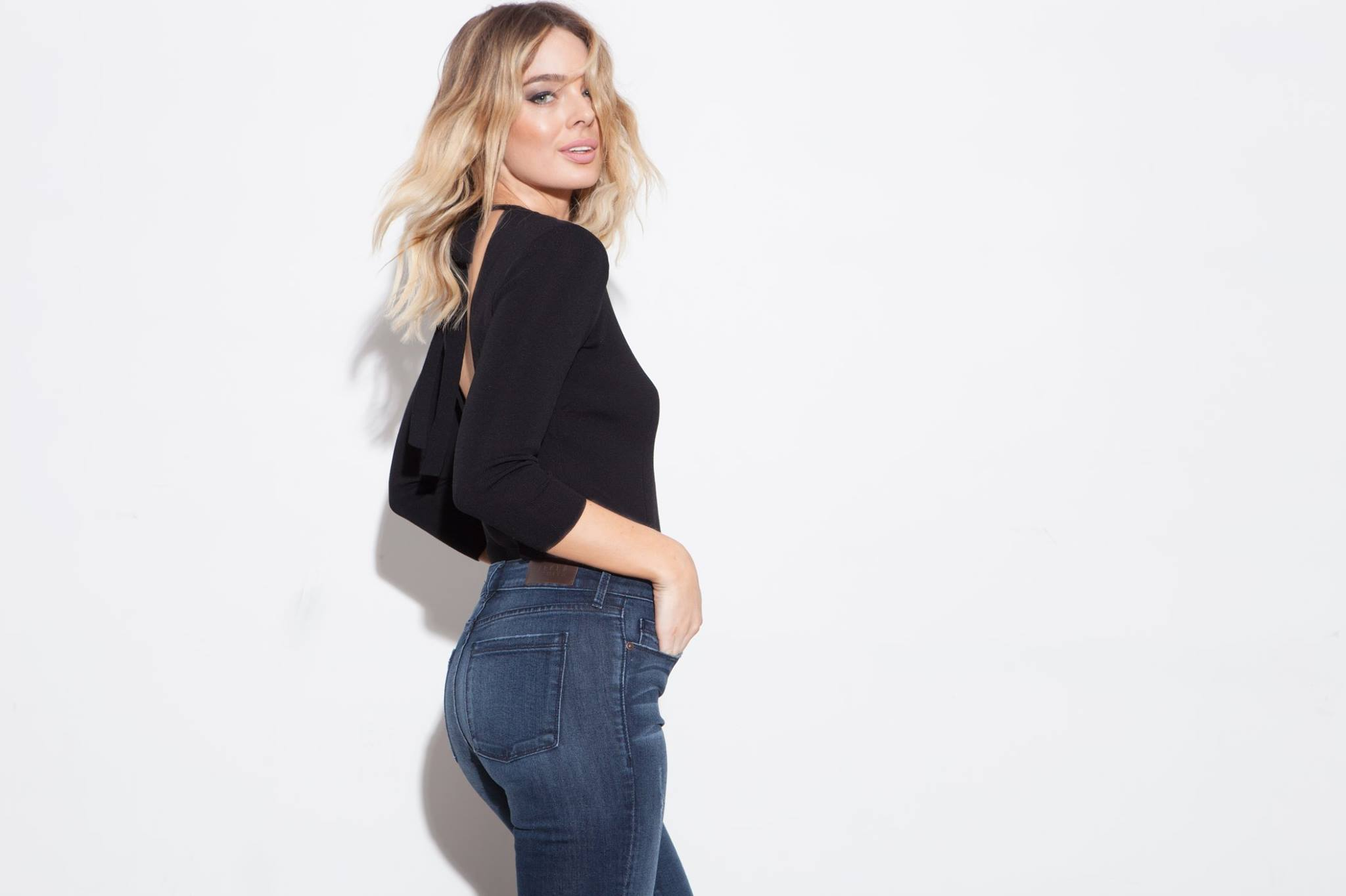 A woman wearing a black shirt and Parker Smith jeans
