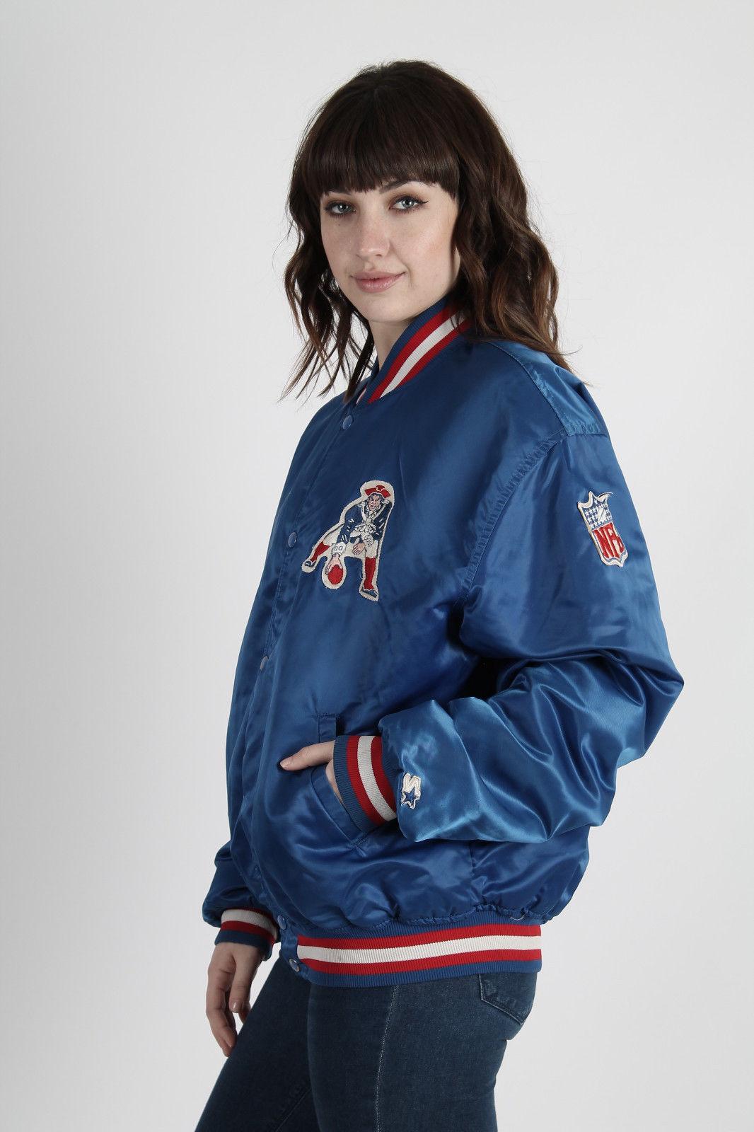 A woman models a vintage satin patriots jacket