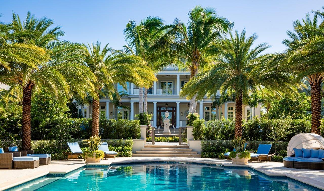British colonial mansion with backyard pool