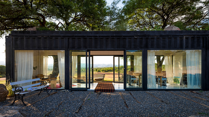 shipping container structure with glass walls