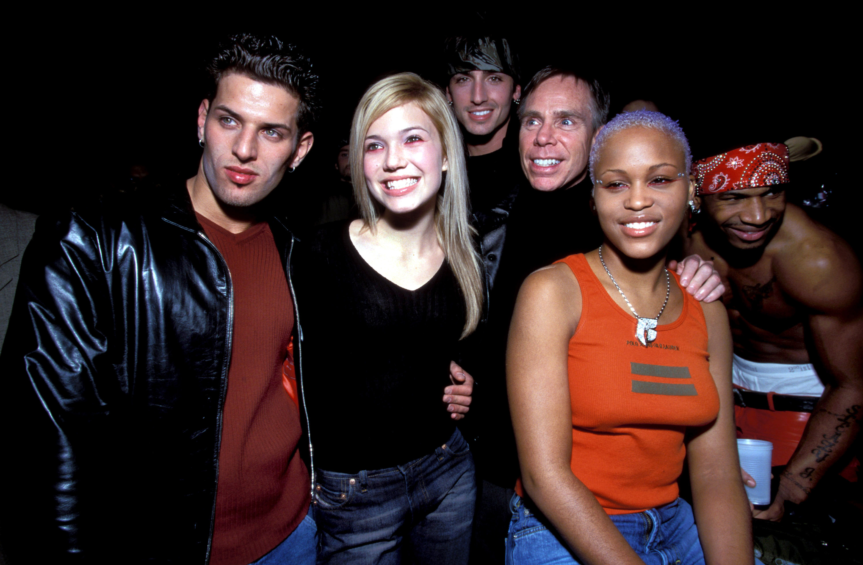 LFO, Mandy Moore, Tommy Hilfiger, and Eve pose at Hilfiger's fall 2000 fashion show.