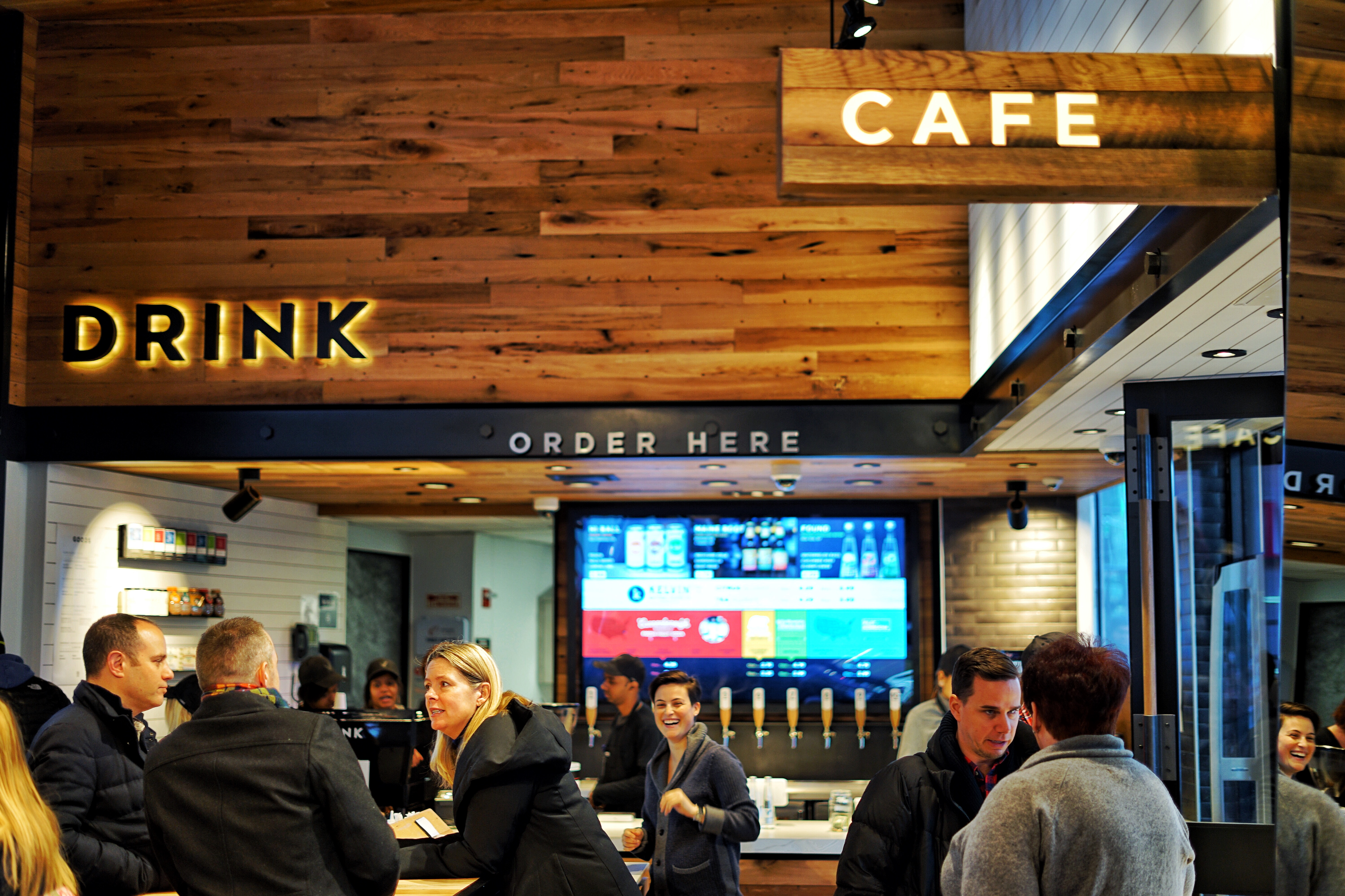 People stand around at American Eagle's Drink cafe in New York City.