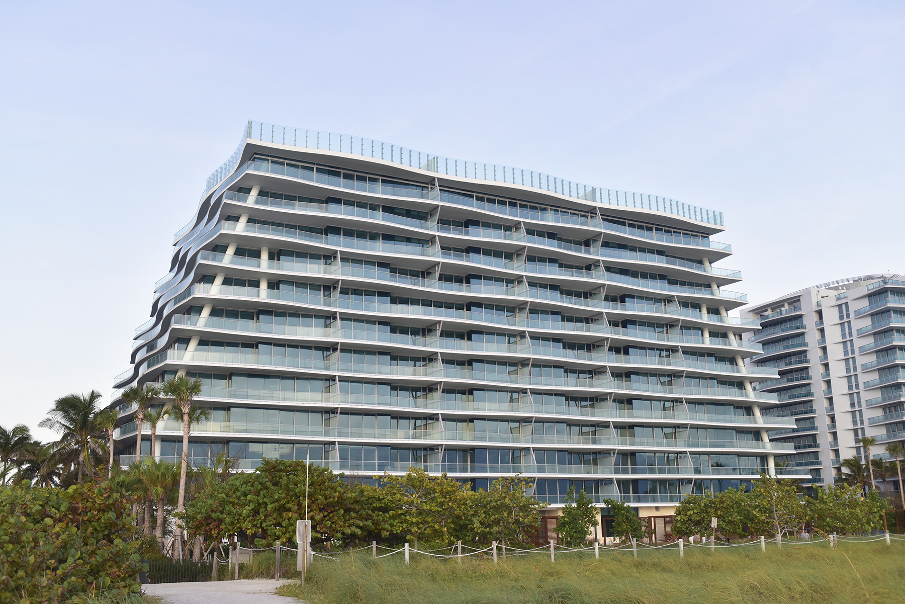 A ground view of FENDI Chateau Residences from the beachside