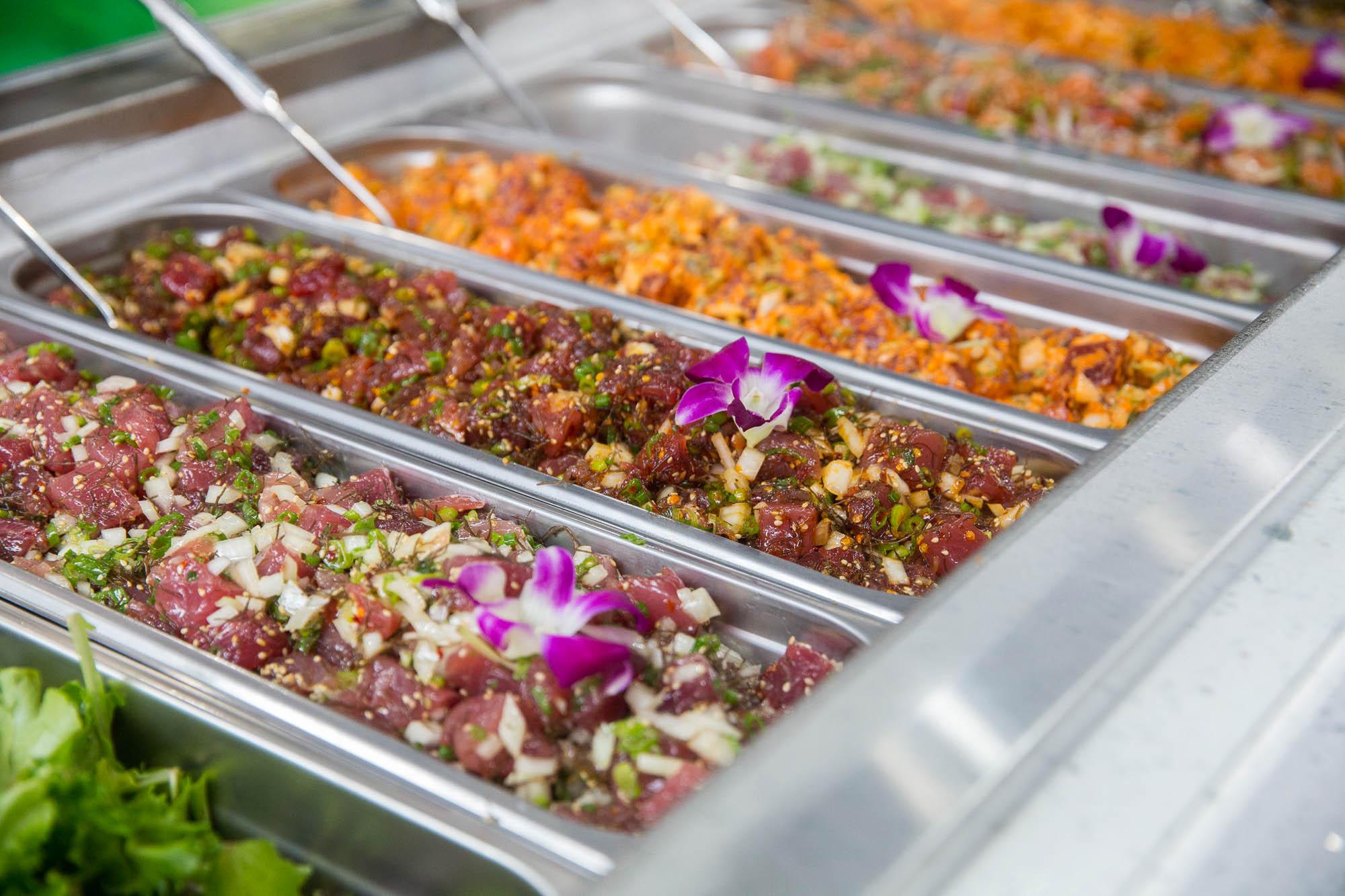 Many varieties of the Hawaiian raw fish salad, poke.