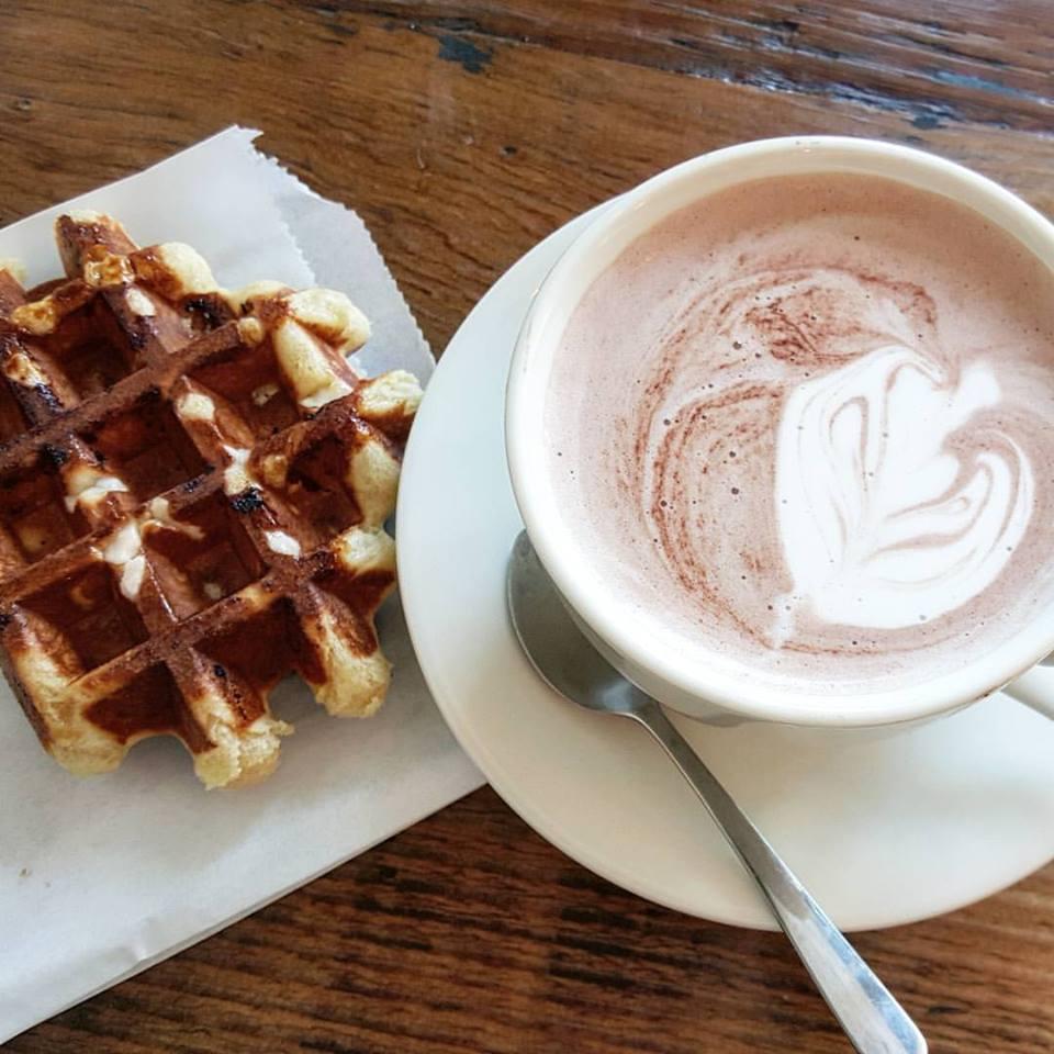 Curio Coffee hot chocolate and waffle