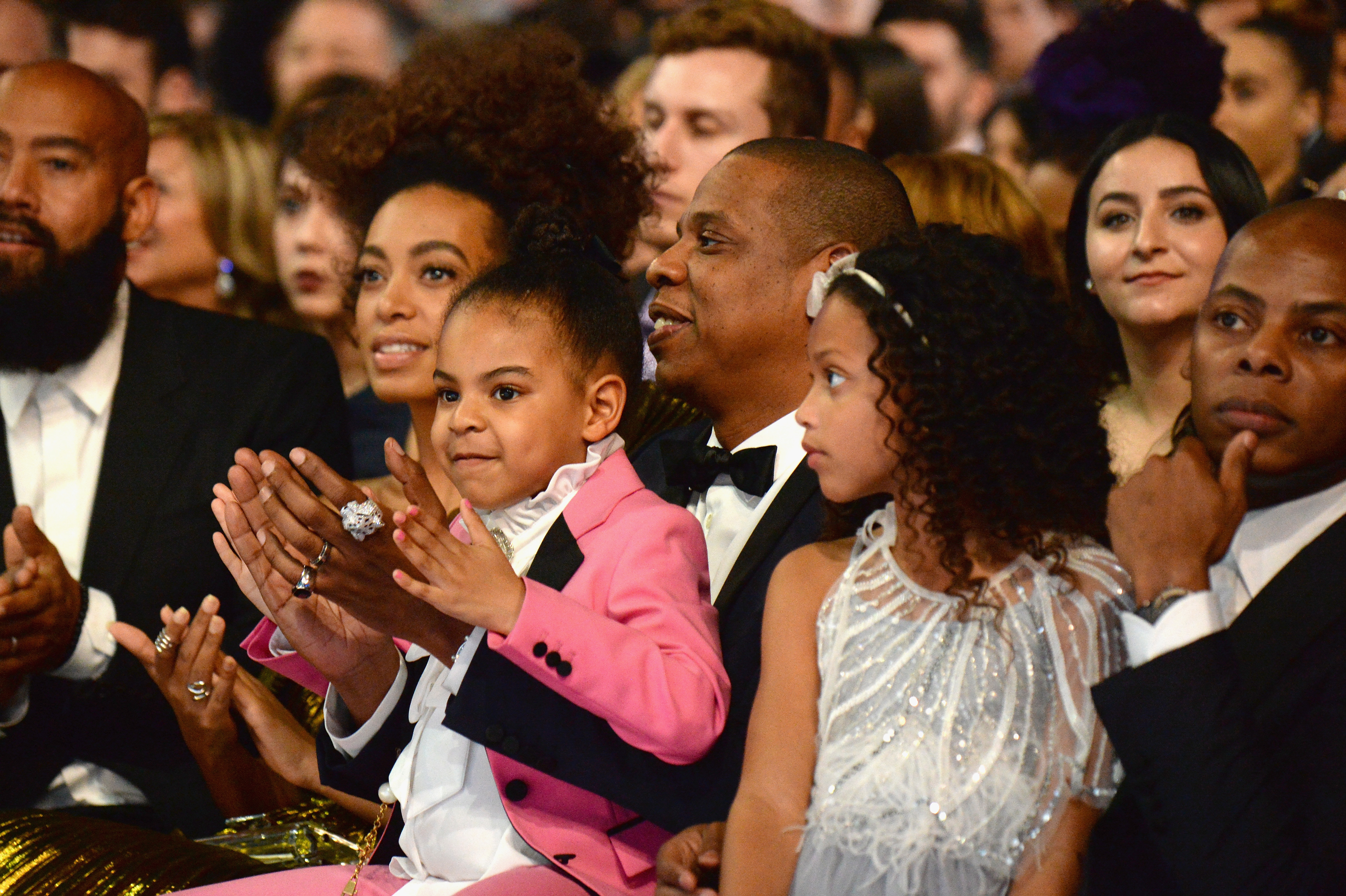 Blue Ivy Carter with her dad and a crowd at the Grammys