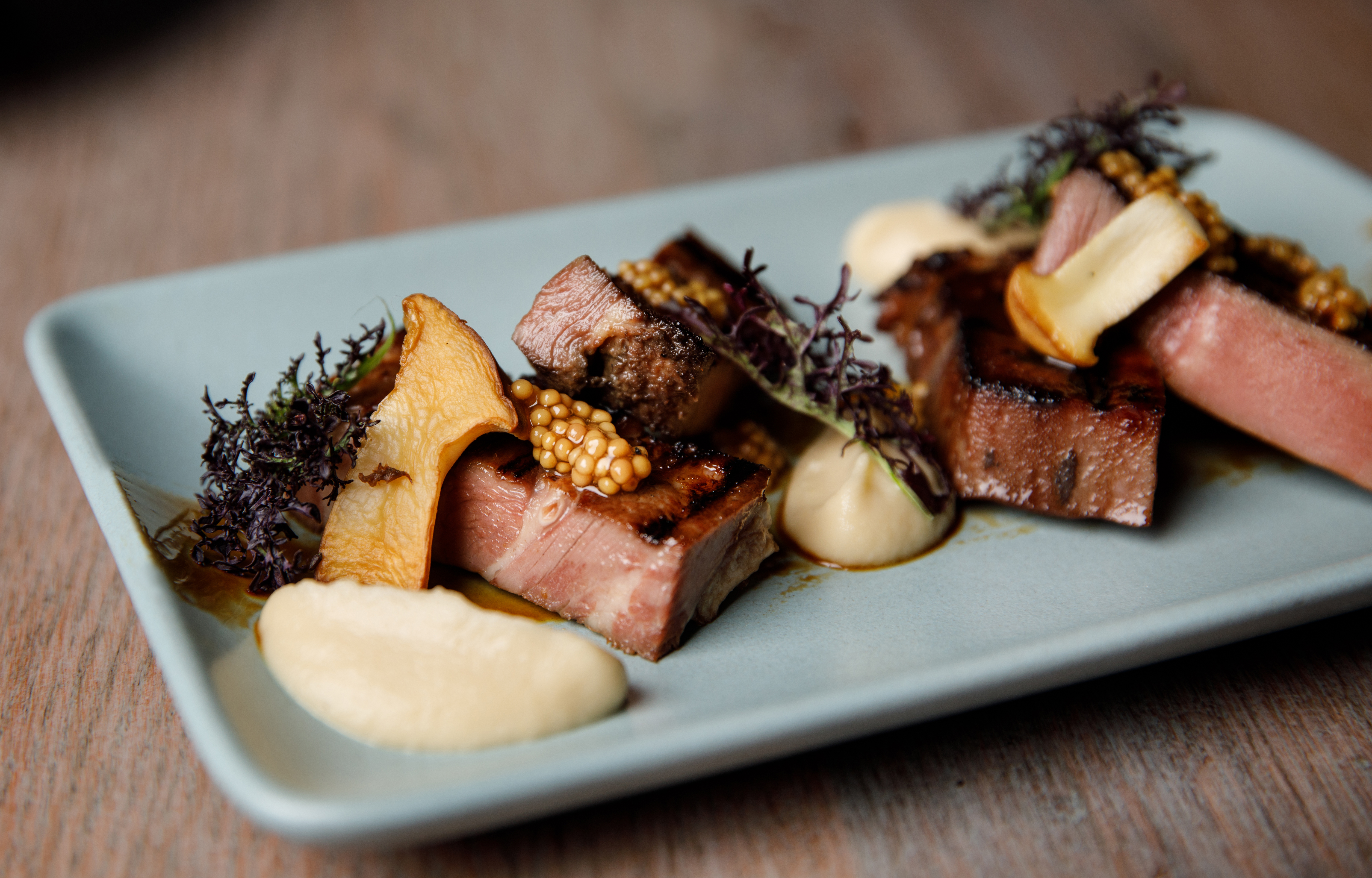 Beef tongue with miso onion, trumpet mushrooms, charred onion, and pickled mustard