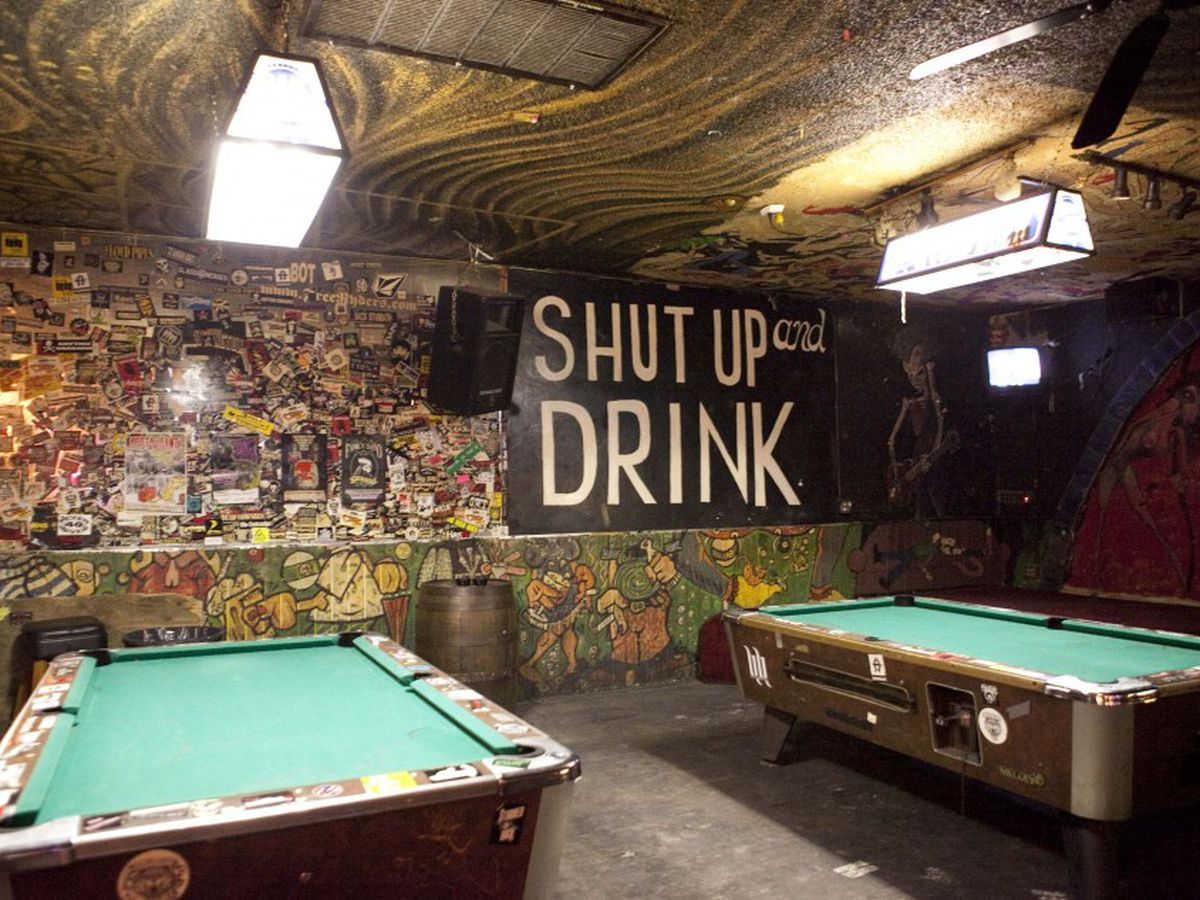 Pool tables in a dive bar