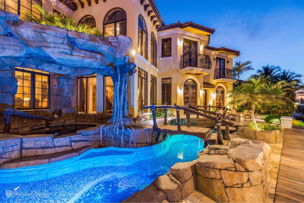 a backyard grotto at a waterfront home in boca